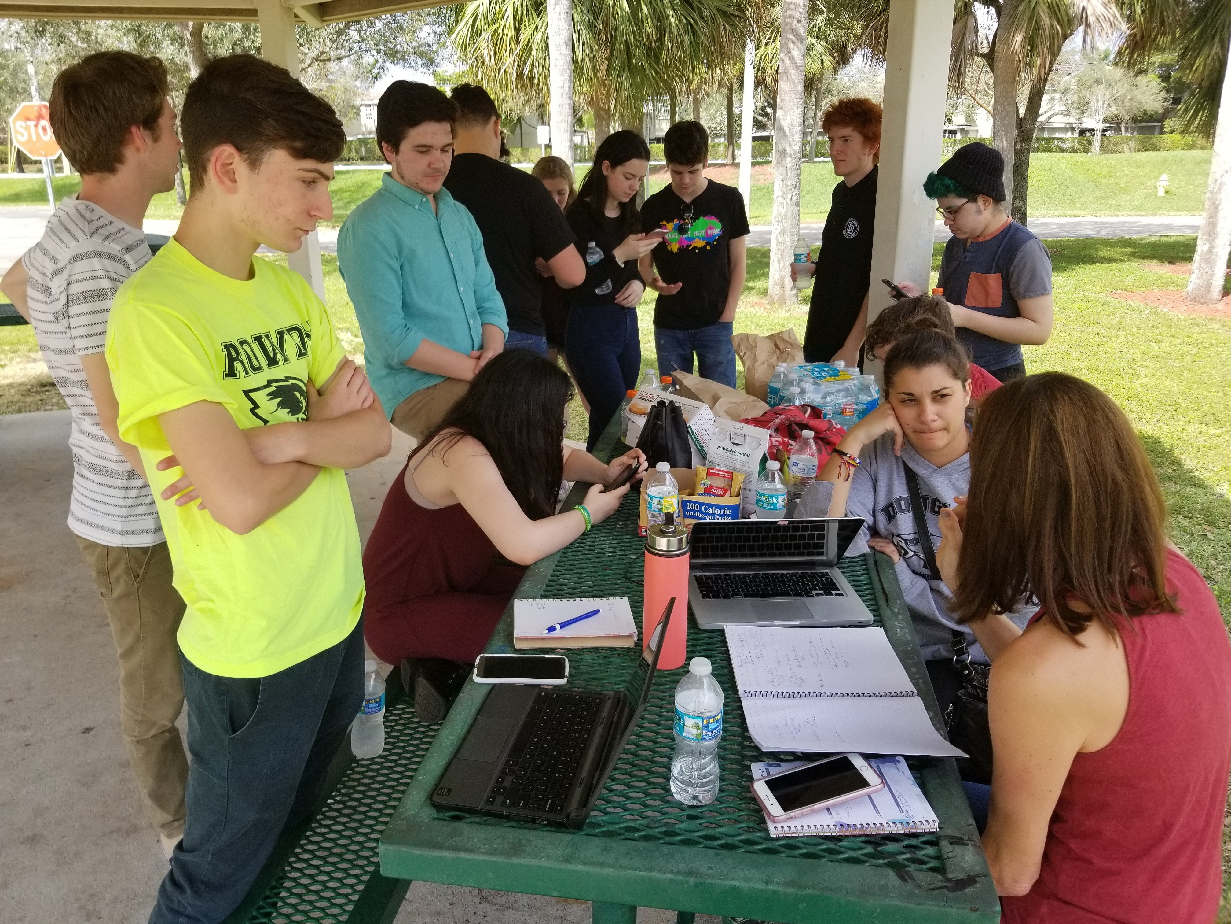 Students from Marjory Stoneman Douglas High School use a picnic table at a city park as a media center to plan their rallies on Washington, D.C., and around the country.