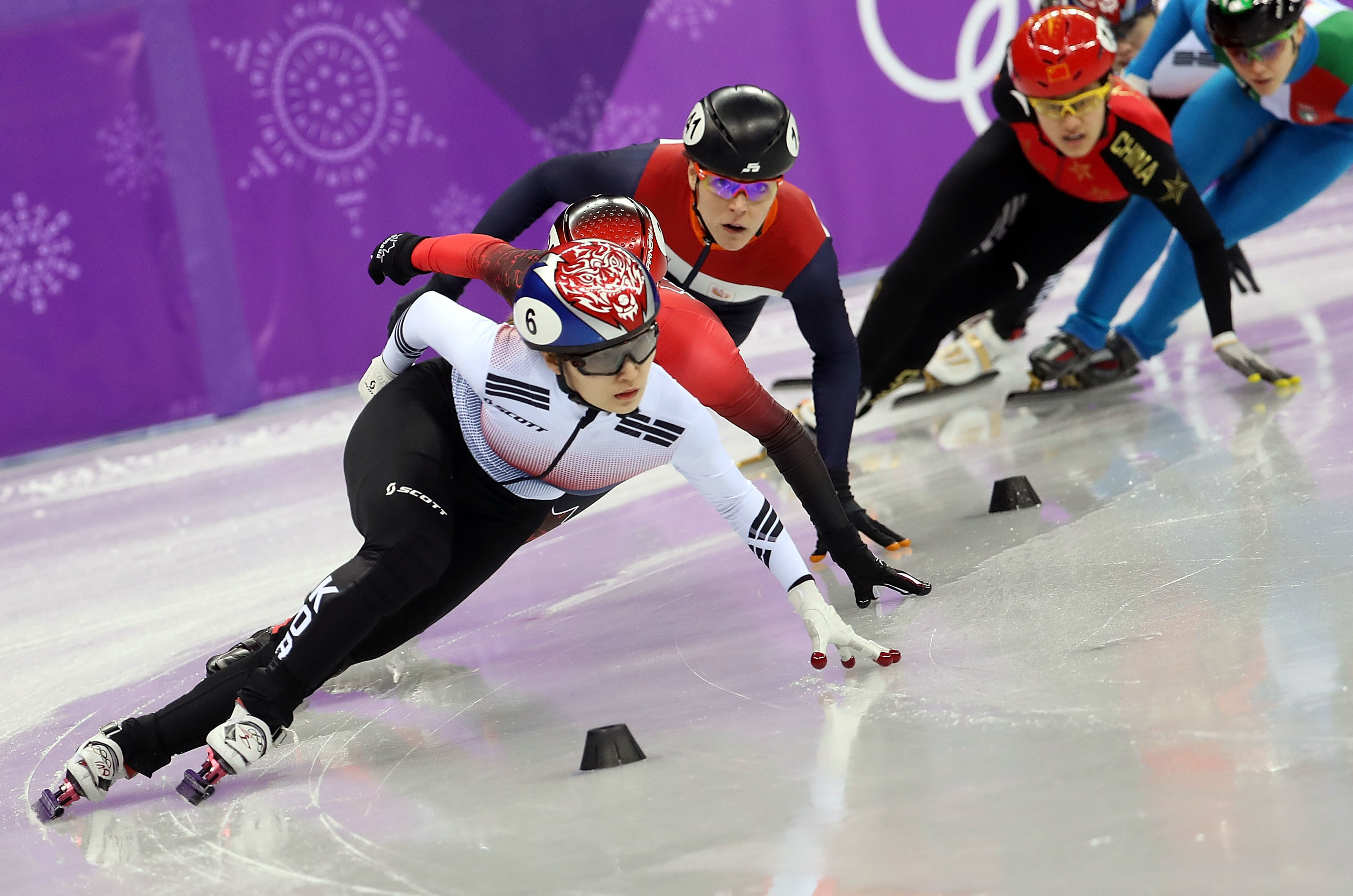 Skaters compete in the 1,500-meter women's short track. The ice for short track speedskating is thicker and warmer than long track ice. Hockey ice is warmer still.