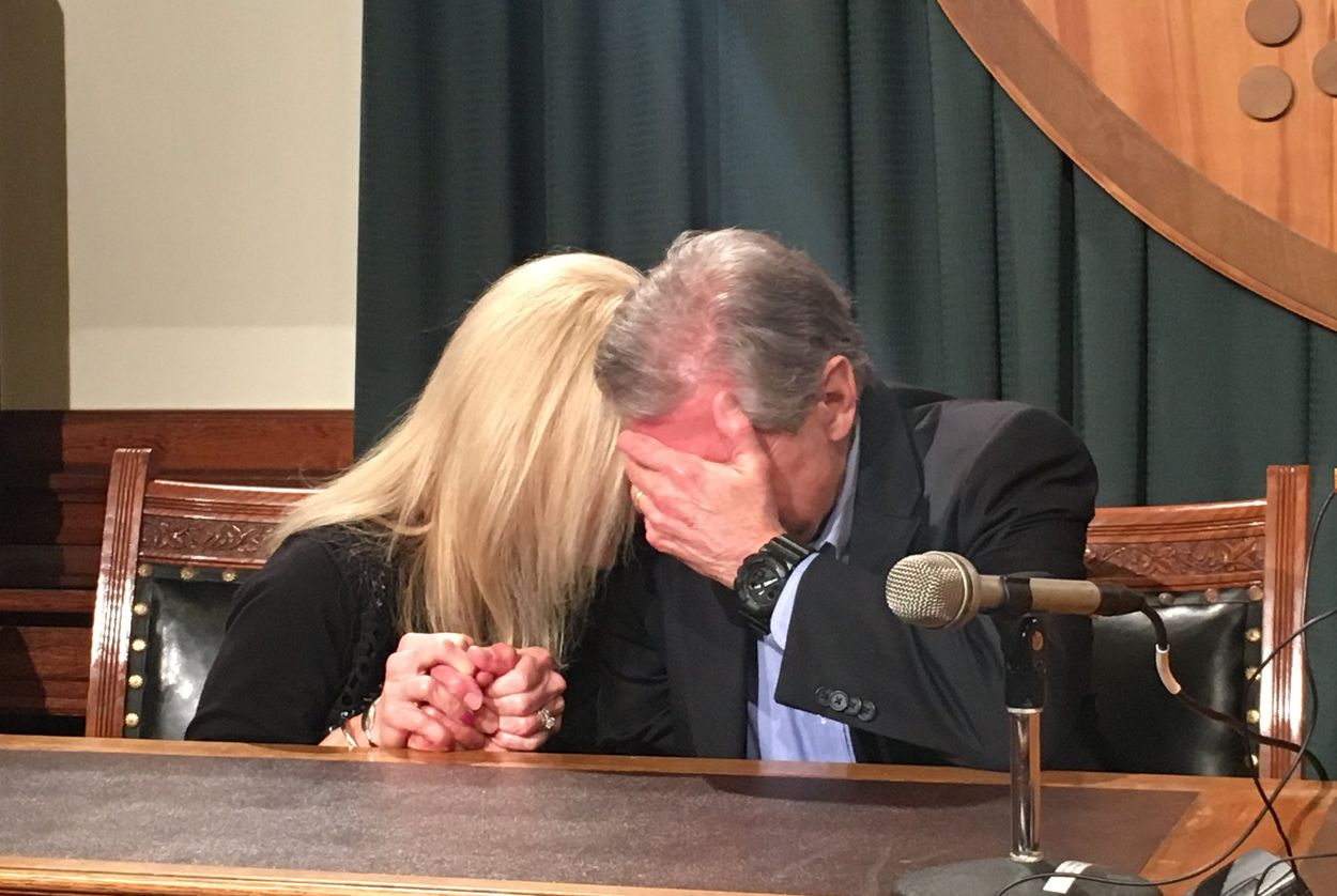 Kent Whitaker and his wife weep upon hearing the news that the parole board recommended to change his son's death sentence to life in prison.