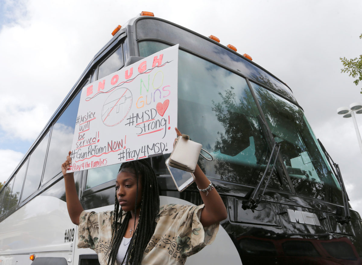 Tyra Hemans, 19, a senior at Marjory Stoneman Douglas High School, boards buses with fellow students to travel to Tallahassee, Florida to meet with legislators in Coral Springs, Florida.