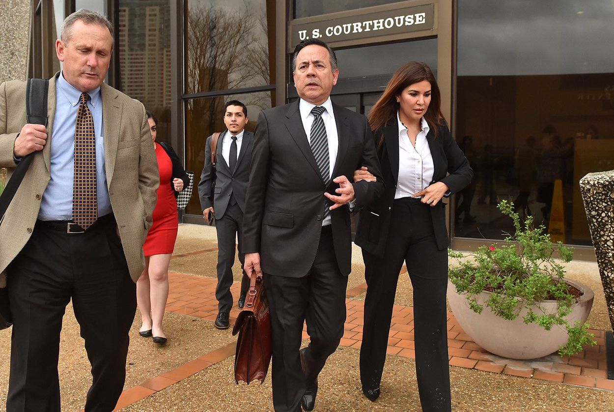 State Sen. Carlos Uresti, D-San Antonio (center) leaves the federal courthouse in San Antonio with his wife, Lleana Uresti and attorney Tab Turner, on Tuesday, Feb. 20, 2018.