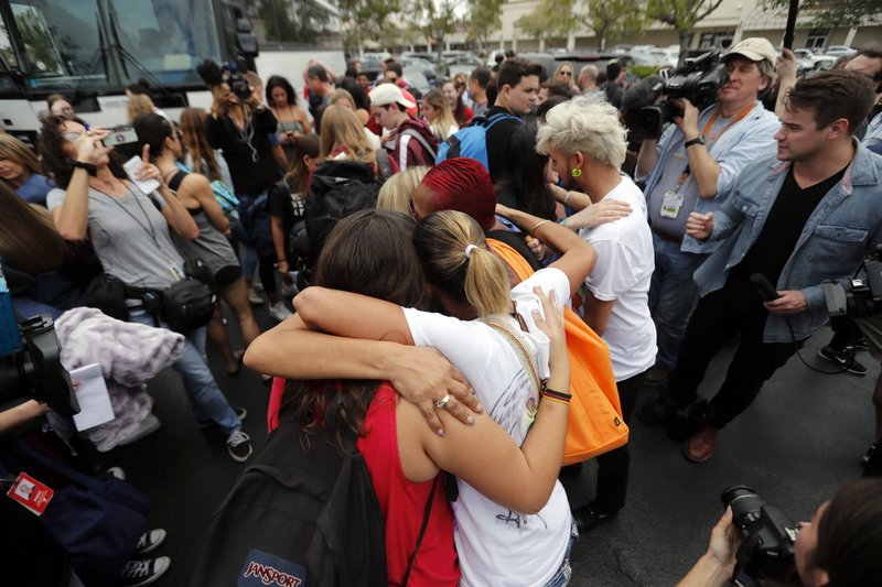 Students who survived the Florida school shooting met survivors of the Pulse Nightclub shooting before boarding buses to head to the state capitol to demand action on gun reform.