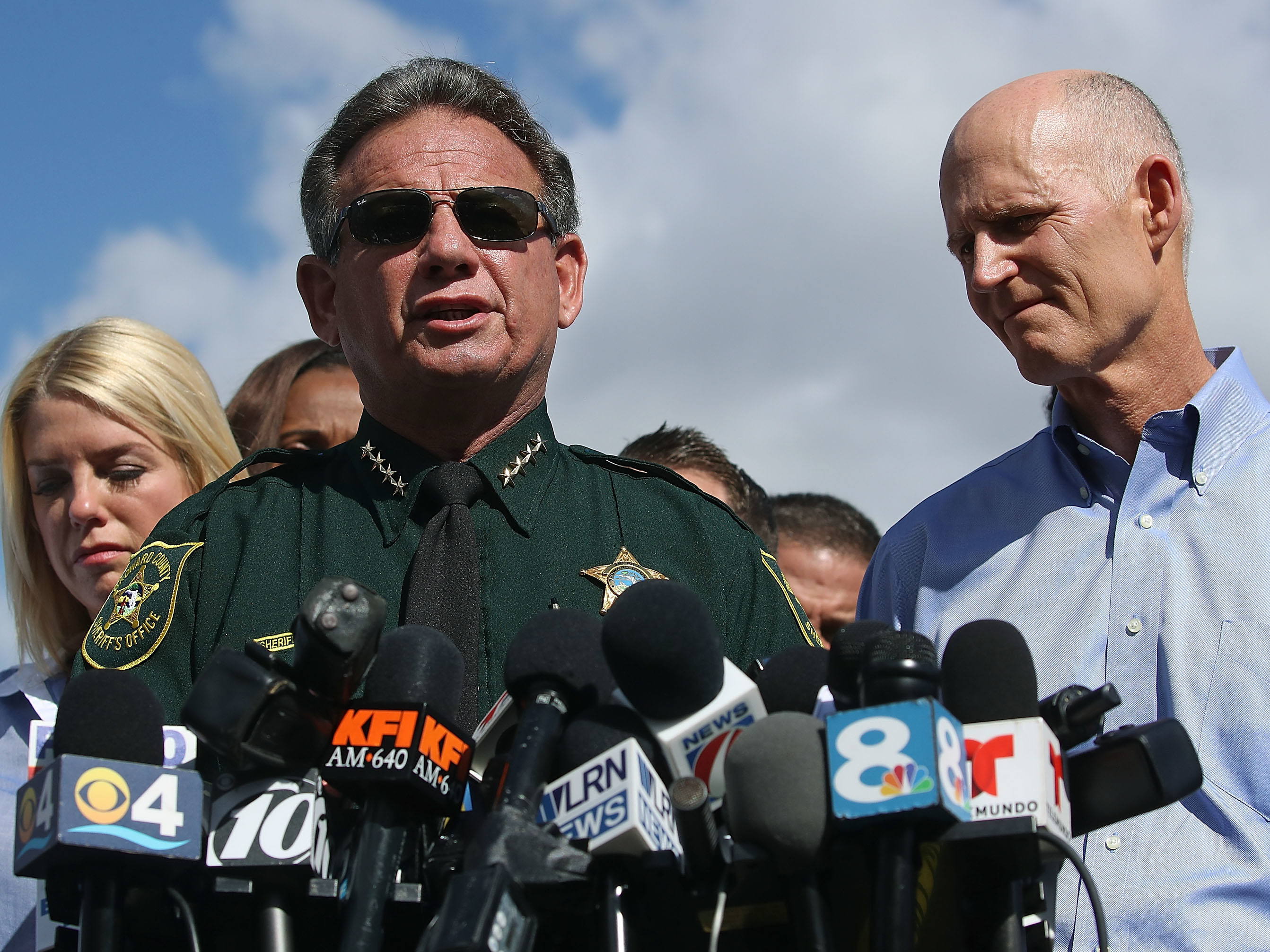 Some Republican lawmakers in Florida are calling on Gov. Rick Scott to remove Broward Sheriff Scott Israel. The sheriff (center) and Scott (right) are seen here on Feb. 15, the day after the shooting.