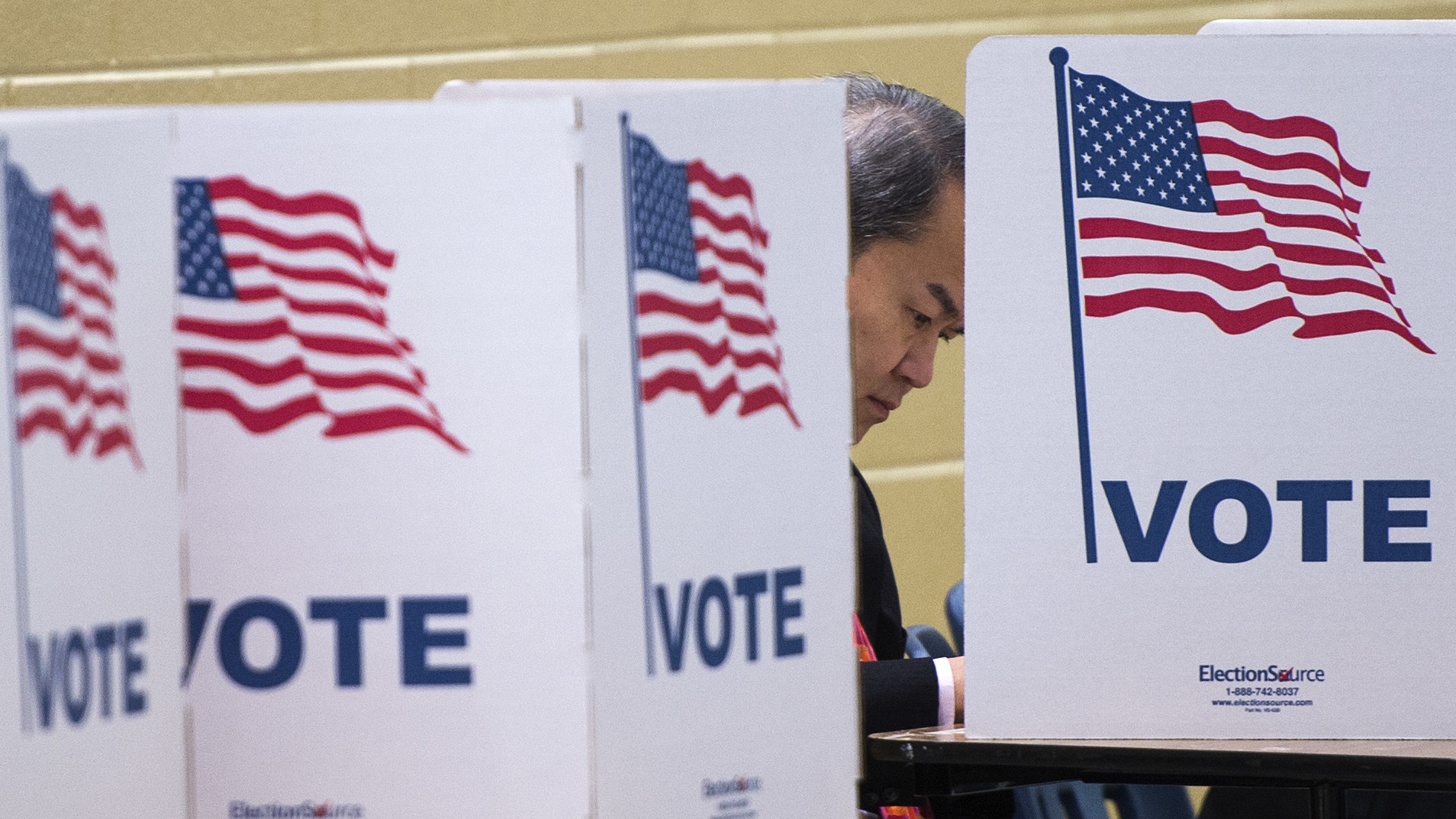 A man votes at a polling place in McLean, Va., in 2016.