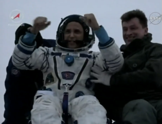 NASA astronaut Joe Acaba gives a thumbs-up to the cameras after landing with his fellow International Space Station Expedition 54 crew members near Dzhezkazgan, Kazakhstan, at 9:31 p.m. EST Tuesday, Feb. 27, 2018, after 168 days in space. Credits: NASA Television