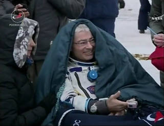 NASA astronaut Mark Vande Hei enjoys his first moments of fresh air on Earth after landing with his fellow International Space Station Expedition 54 crew members near Dzhezkazgan, Kazakhstan, at 9:31 p.m. EST Tuesday, Feb. 27, 2018, after 168 days in space.