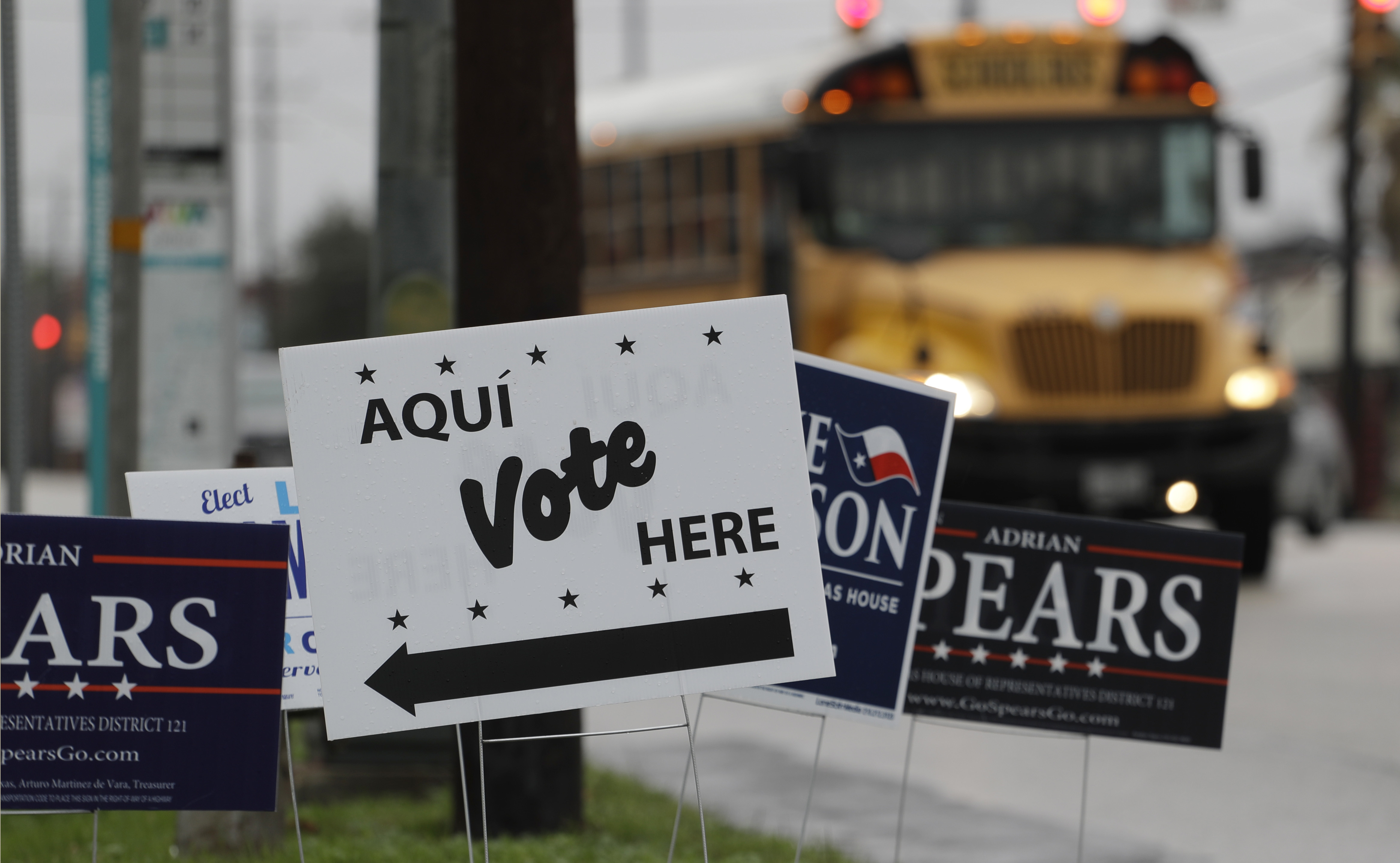 Signs mark a polling site as early voting begins, Tuesday, Feb. 20, 2018, in San Antonio. Early voting in Texas runs though March 2, 2018. (AP Photo/Eric Gay)