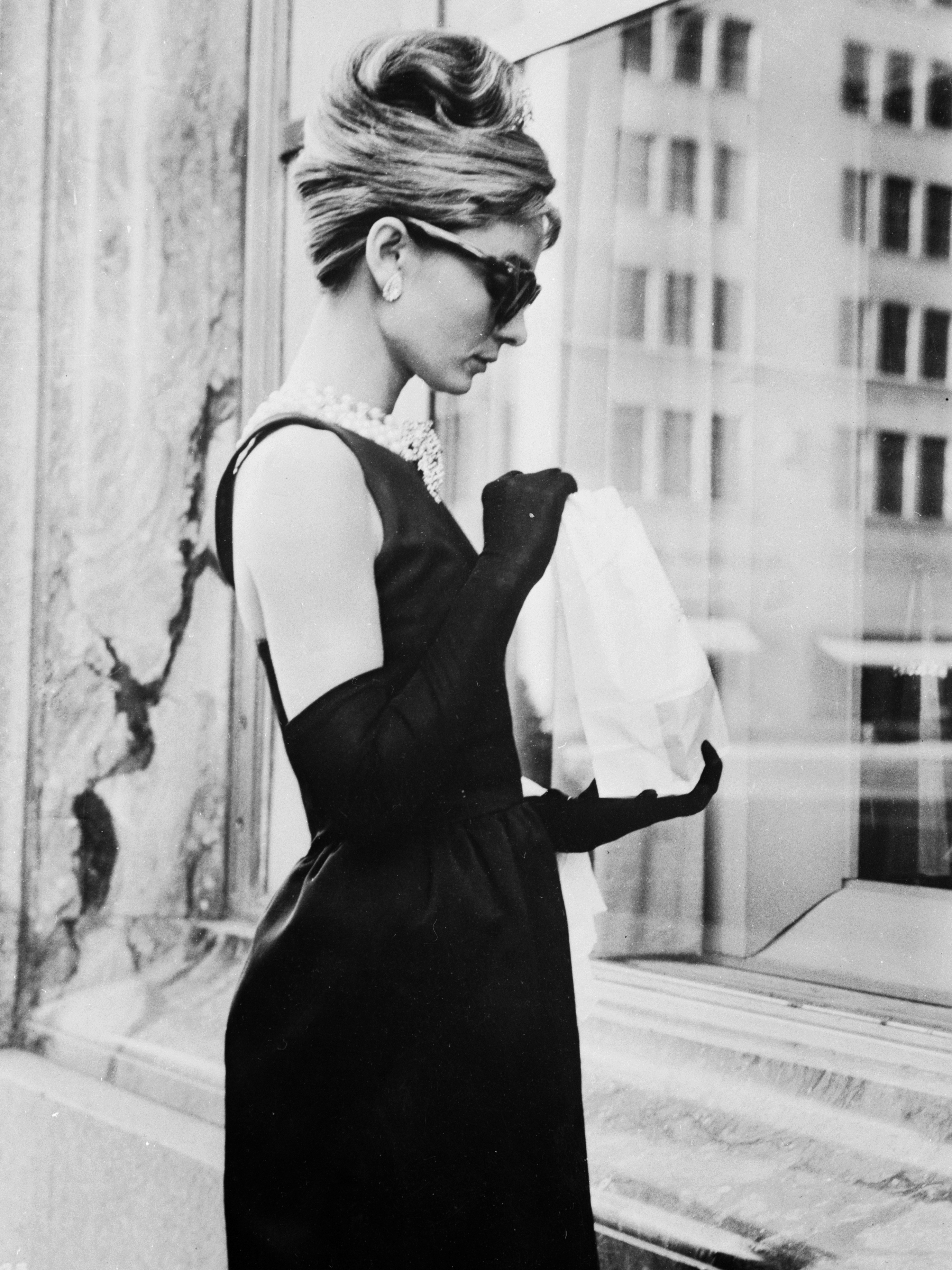 Audrey Hepburn wears a black dress by Givenchy in the opening scene of 1961's Breakfast At Tiffany's.