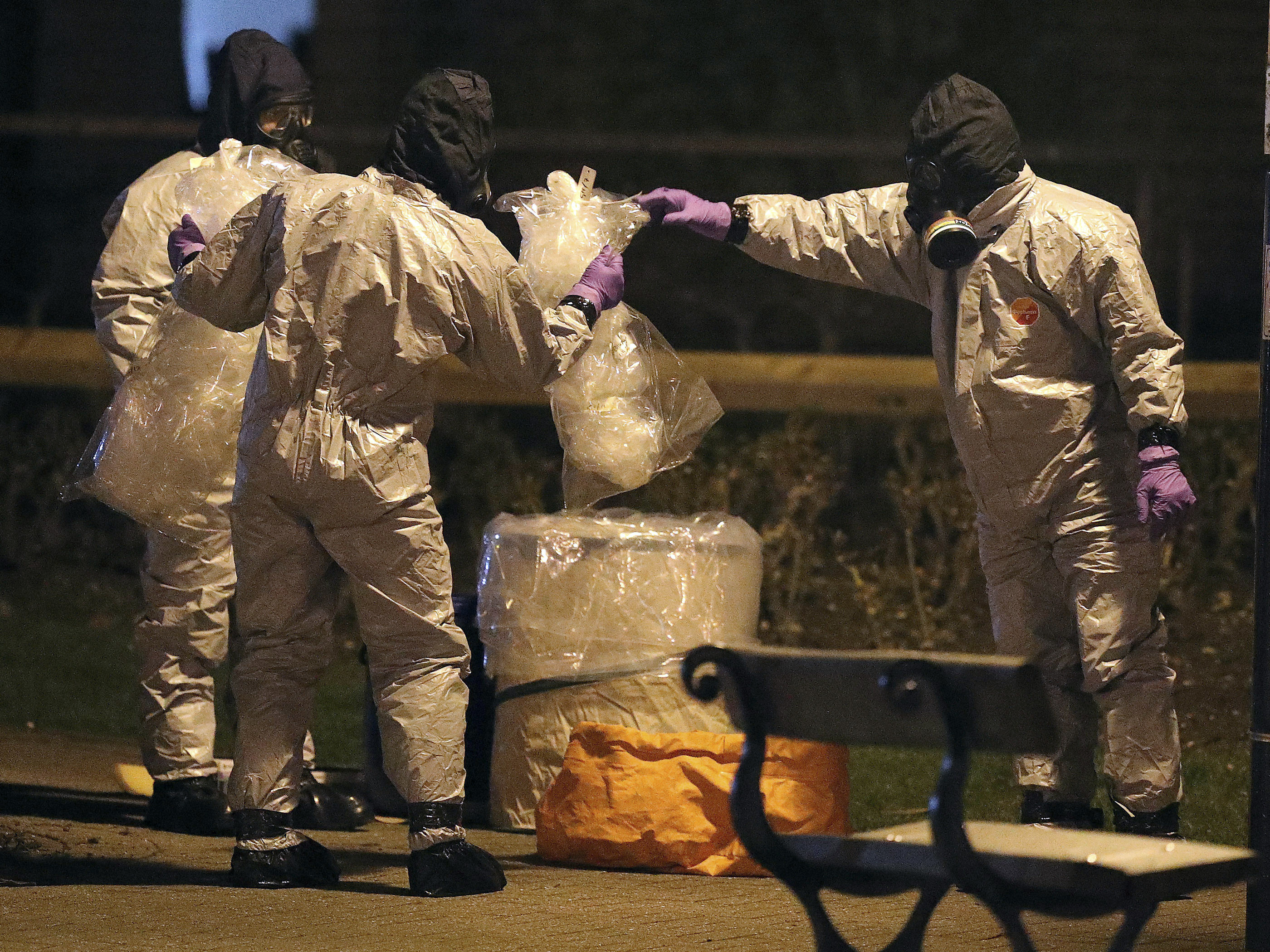 Investigators in protective suits work at the scene in the Maltings shopping center in Salisbury, England, on Tuesday.