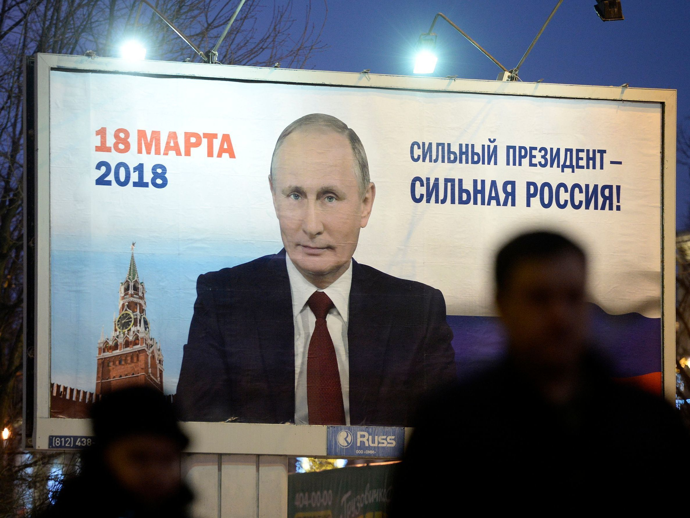 A billboard in Saint Petersburg shows an image of Russia's President Vladimir Putin in January 2018. The sign says,
