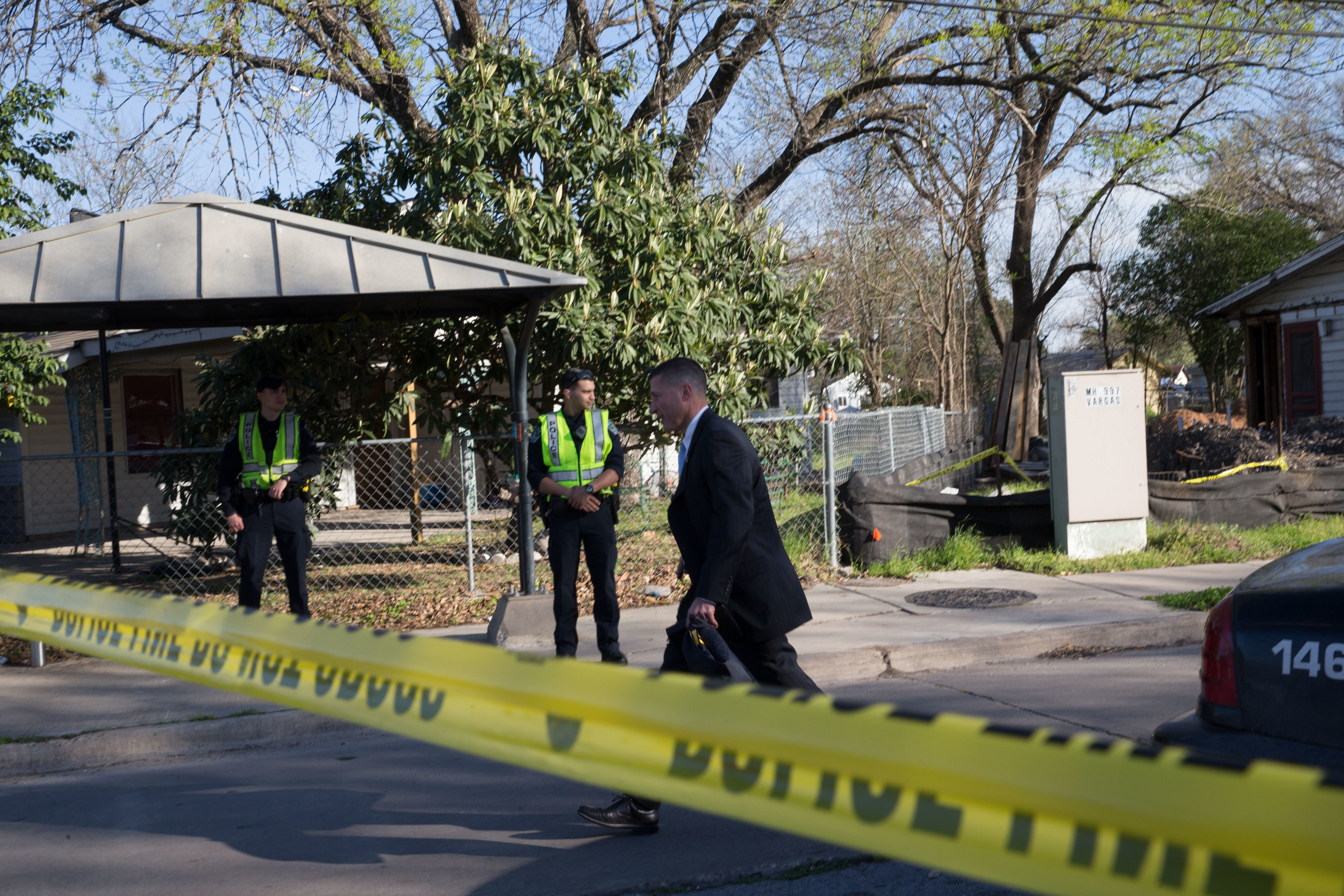 Authorities examine the scene of a bombing in Austin, Texas, on March 12. A woman in her 70s was injured in the explosion. Officials have said there is a serial bomber attacking the Austin area.