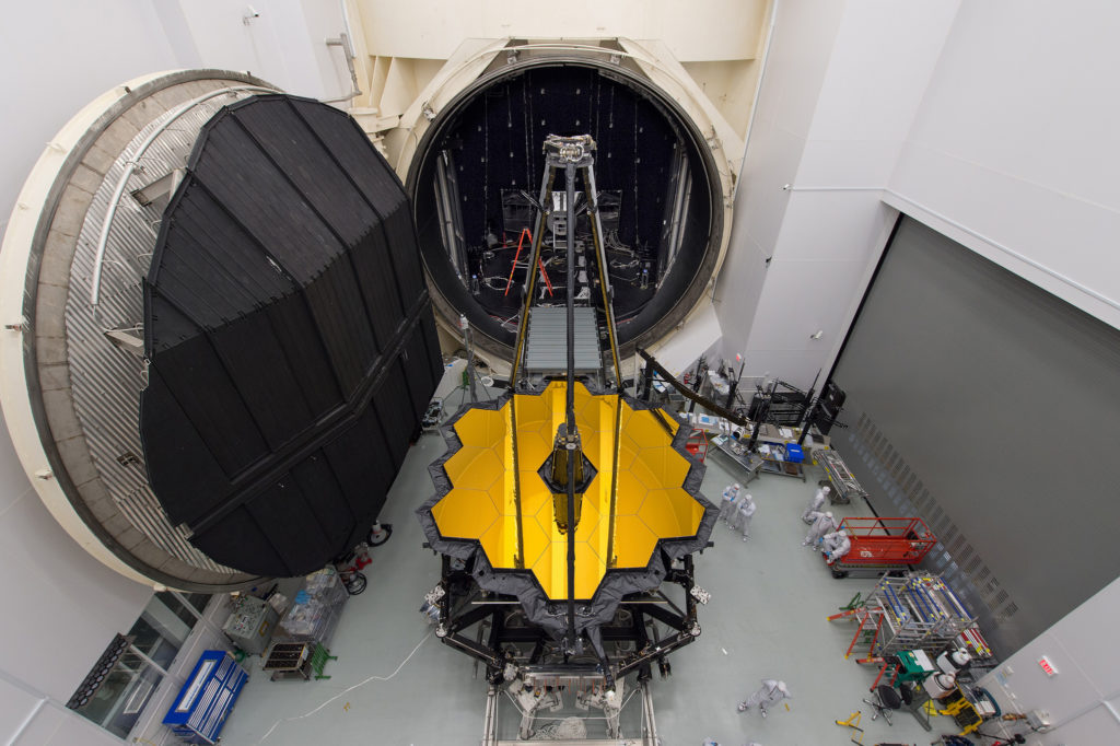 NASA's James Webb Space Telescope sits in front of the door to Chamber A, a giant thermal vacuum chamber located at NASA's Johnson Space Center.