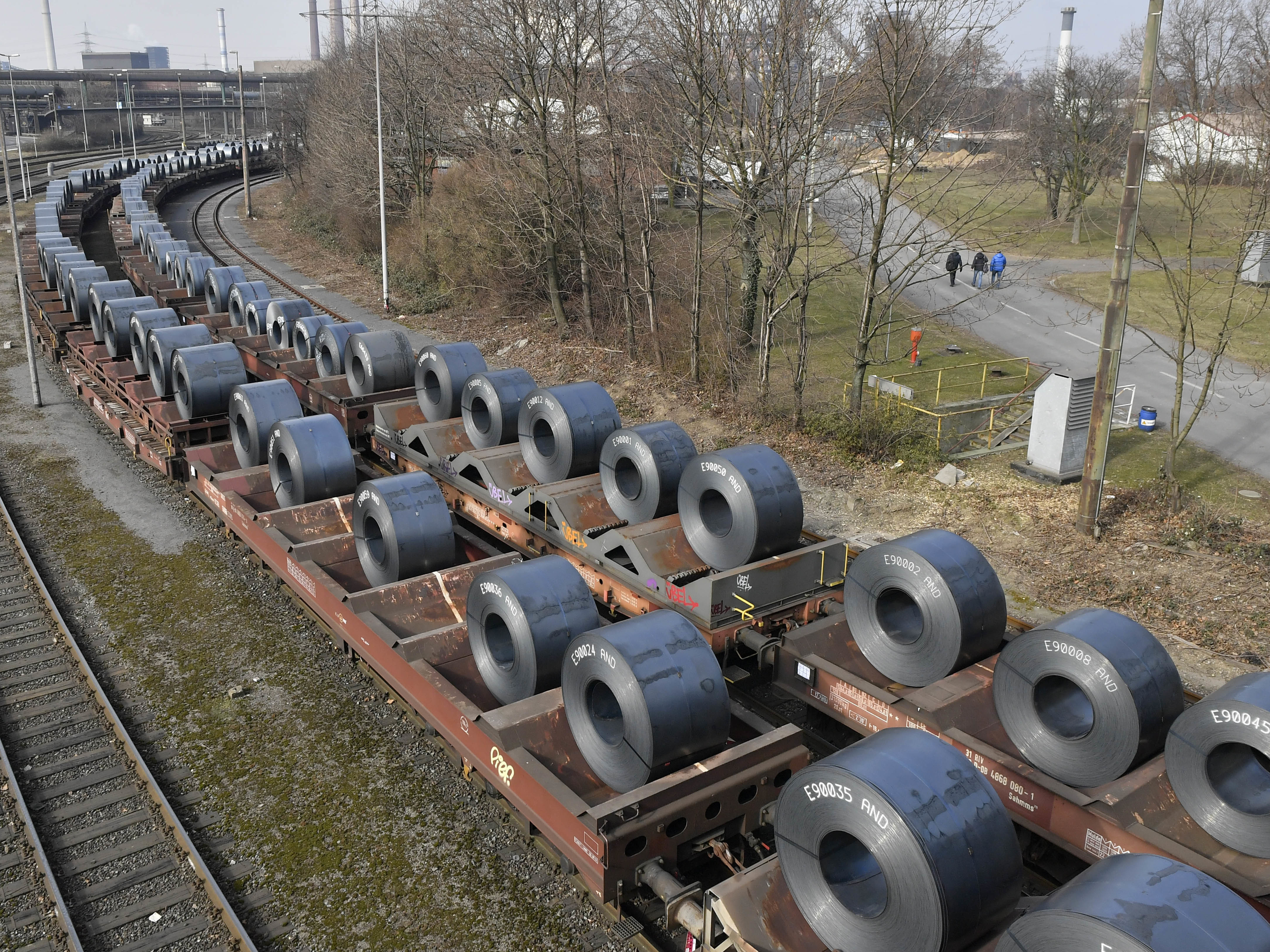 Steel coils sit on wagons leaving a factory in Duisburg, Germanyon March 2. U.S. President Trump Monday decided to hold off on imposing most steel and aluminum tariffs until at least June 1