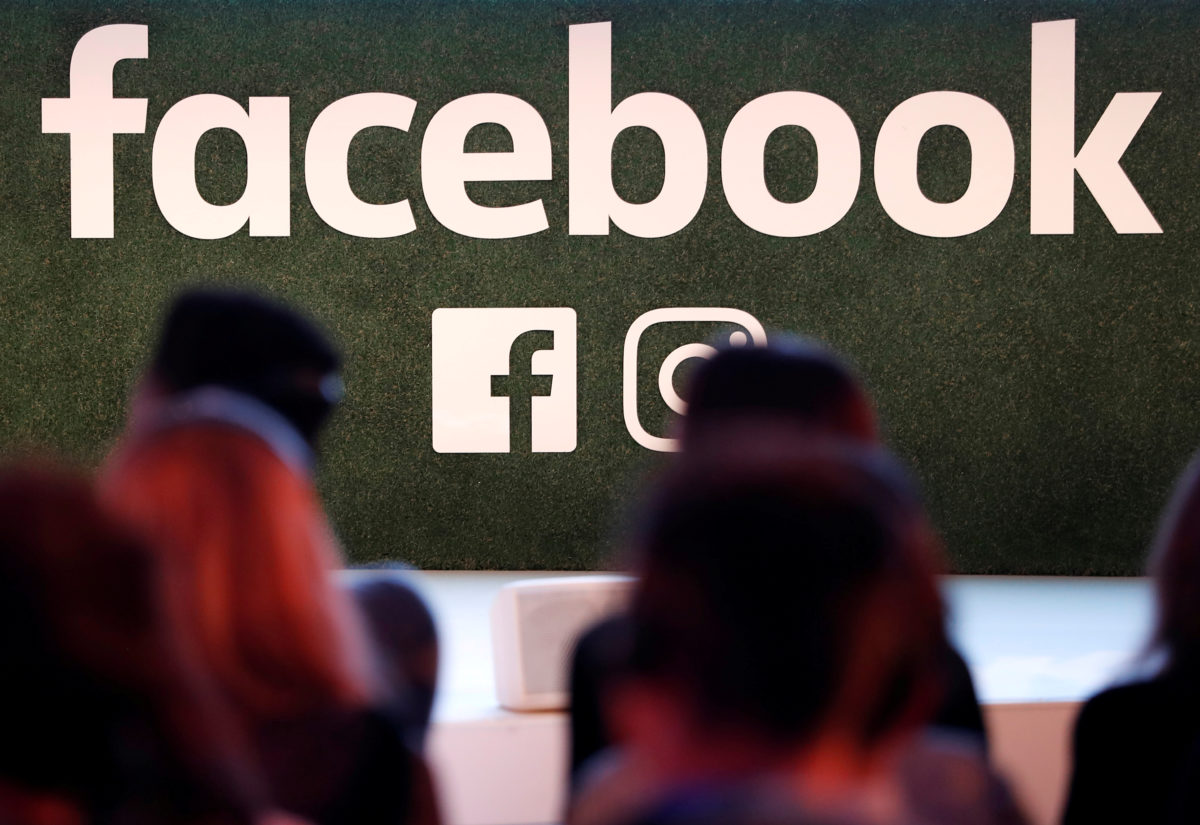 FILE PHOTO: A Facebook logo is seen at the Facebook Gather conference in Brussels, Belgium January 23, 2018.