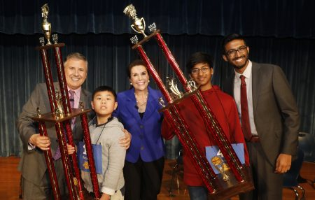 From left to right: Ernie Manouse (Host), Benjamin Chen (Runner up), Lisa Shumate (Associate Vice President and General Manager), Pranav Chemudupaty (Champion) and Anjay Ajoda (Three time Houston Spelling Bee Champion)