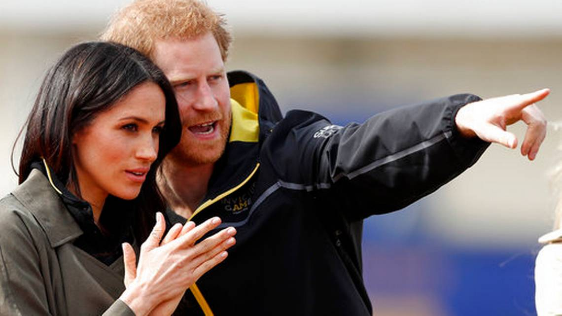 Britain's Prince Harry and his fiancee Meghan Markle attend the UK team trials for the Invictus Games Sydney 2018 at the University of Bath in Bath, England, Friday, April 6, 2018.
