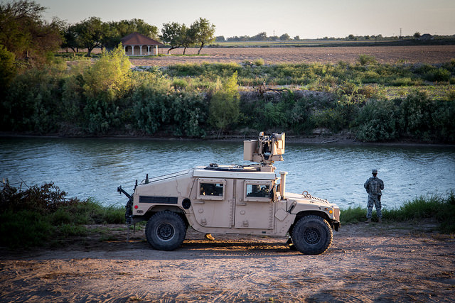 A soldier from the 36th Infantry Division, Texas Army National Guard, observes a section of the Rio Grande in support of Operation Strong Safety.