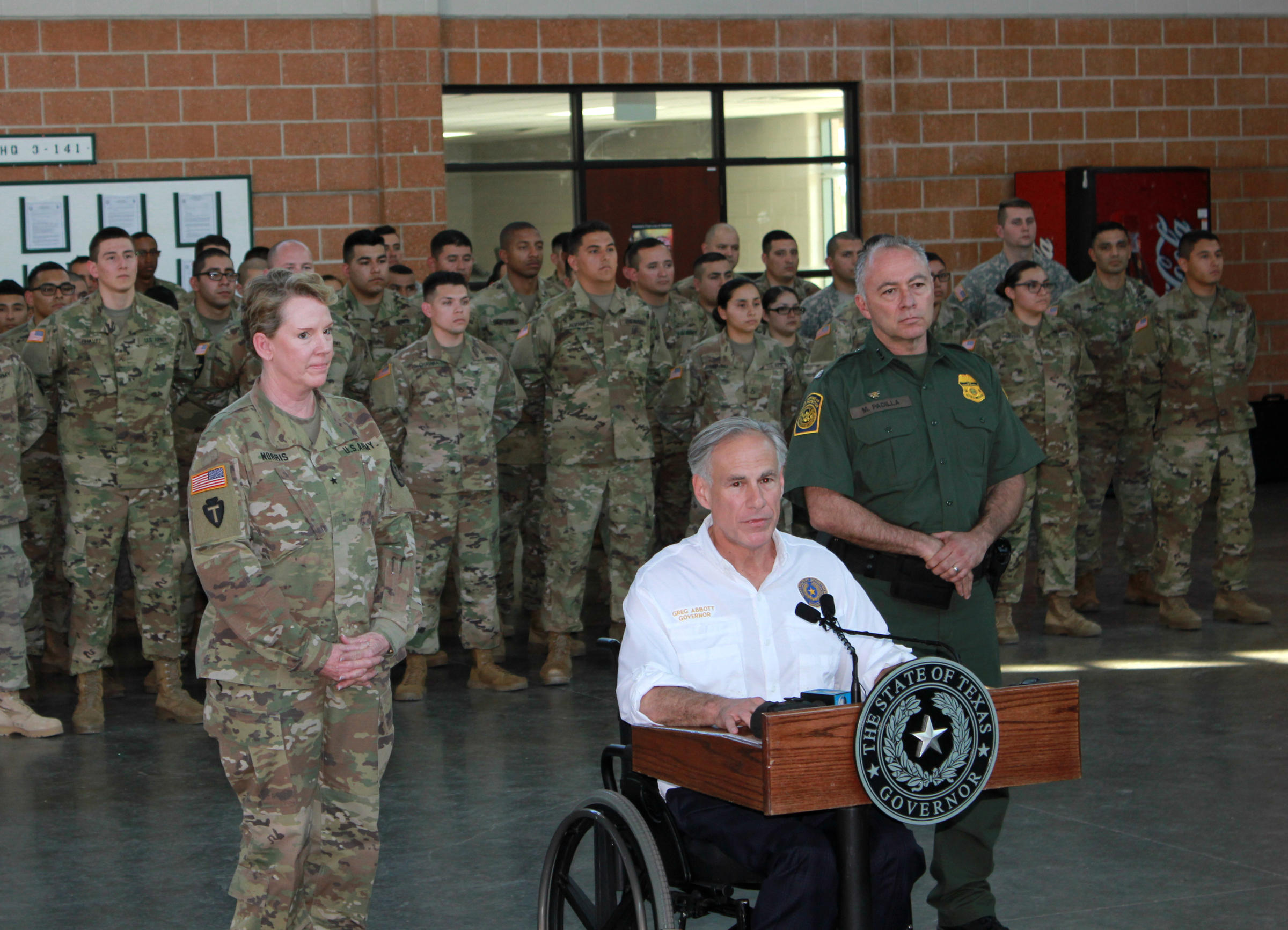 Gov. Greg Abbott deployed the Texas National Guard to the U.S.-Mexico border. Abbott made the announcement alongside Brig. Gen Tracy Norris of the Texas National Guard, left, and Rio Grande Valley Sector Border Patrol Chief Manuel Padilla.