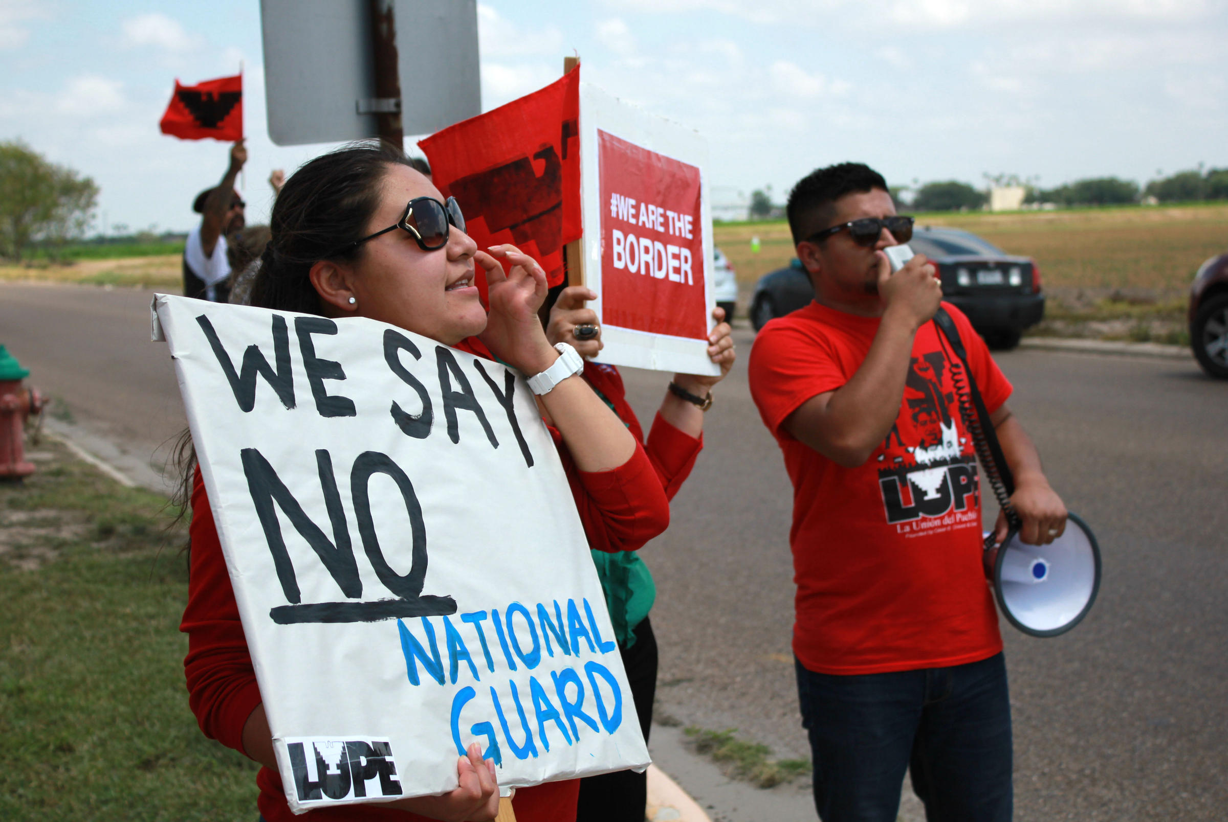 Protesters in Welasco gather as almost 800 National Guard troops are deployed to the U.S.-Mexico border.