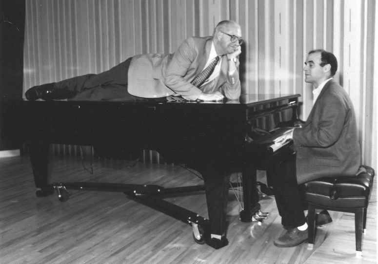 Kasell decides to take a publicity photo shoot up a notch while Wait Wait... Don't Tell Me! host Peter Sagal tickles the ivories.