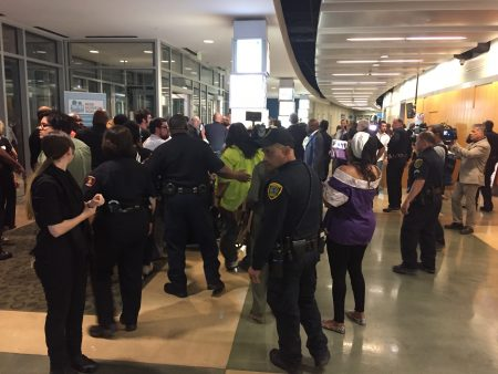 About 100 people were removed from the HISD auditorium after a scuffle with police officers and a protest ensued. The heated meeting was meant to consider a charter partnership for 10 schools, but ended without a vote.