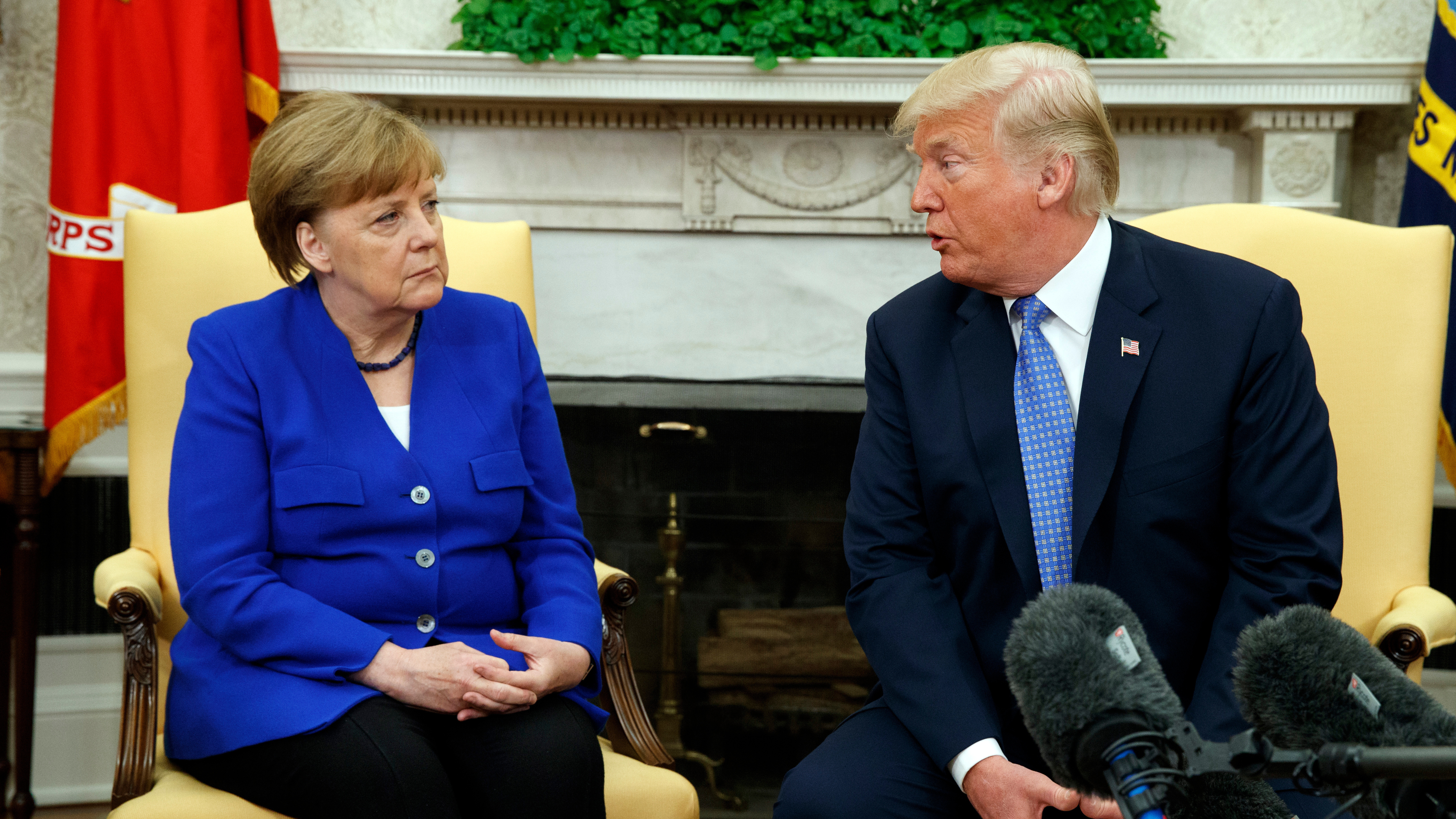 President Donald Trump meets with German Chancellor Angela Merkel in the Oval Office of the White House Friday.