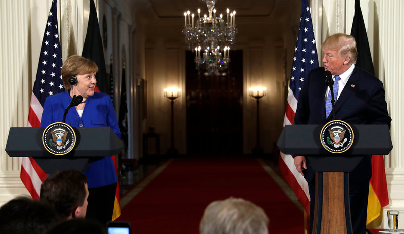 President Donald Trump speaks during a news conference with German Chancellor Angela Merkel in the East Room of the White House on Friday.