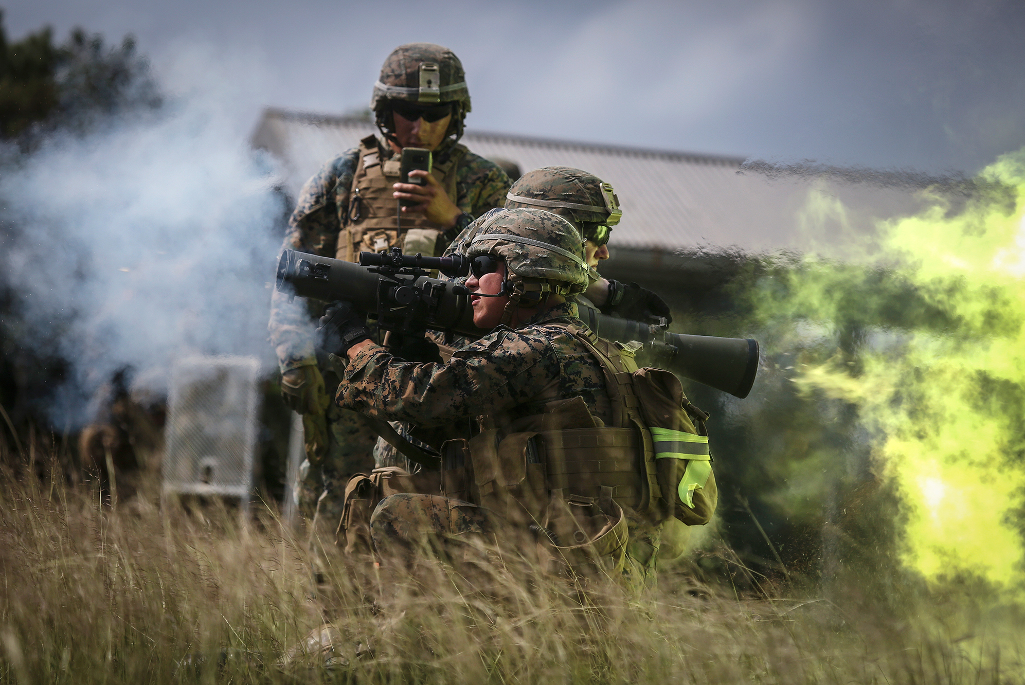 U.S. Marines fire the Carl Gustav rocket system during live-fire training last October. With each firing, the shooter's brain is exposed to pulses of high pressure air emanating from the explosion that travel faster than the speed of sound.