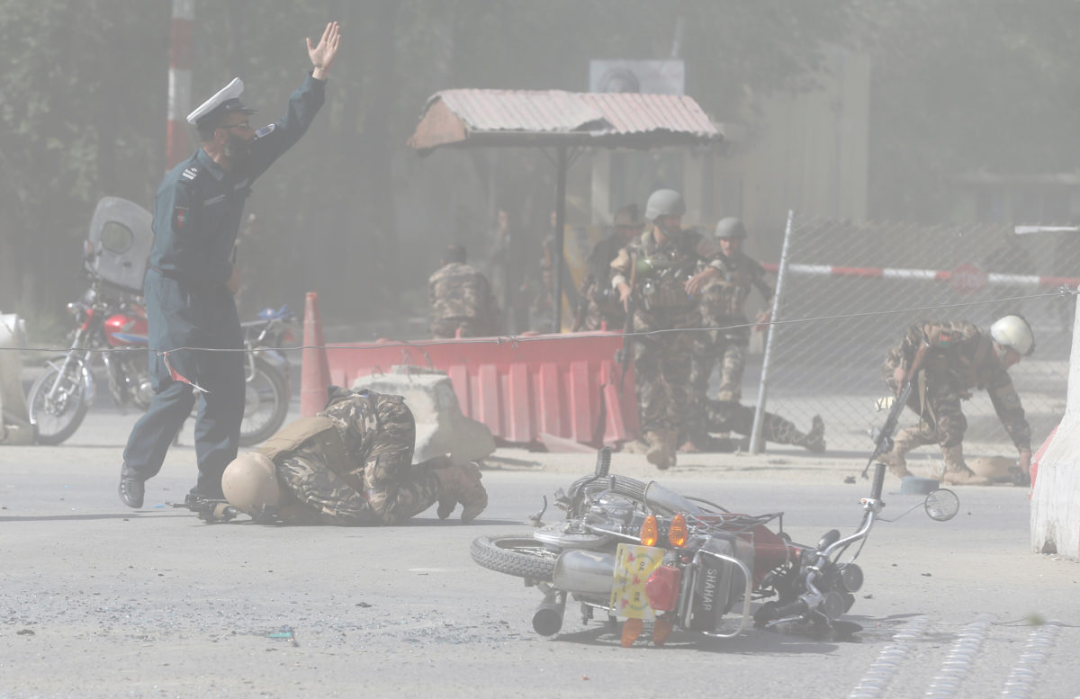 Afghan security forces are seen at the site of a second blast in Kabul, Afghanistan April 30, 2018. REUTERS/Omar Sobhani - RC19C7812B10