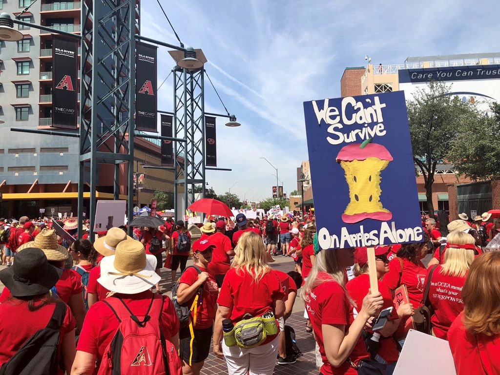 Participants take part in a march in Phoenix, Arizonia, U.S., April 26, 2018 in this picture obtained from social media.  Christy Chavis/via REUTERS   THIS IMAGE HAS BEEN SUPPLIED BY A THIRD PARTY. MANDATORY CREDIT. NO RESALES. NO ARCHIVES - RC17011085E0