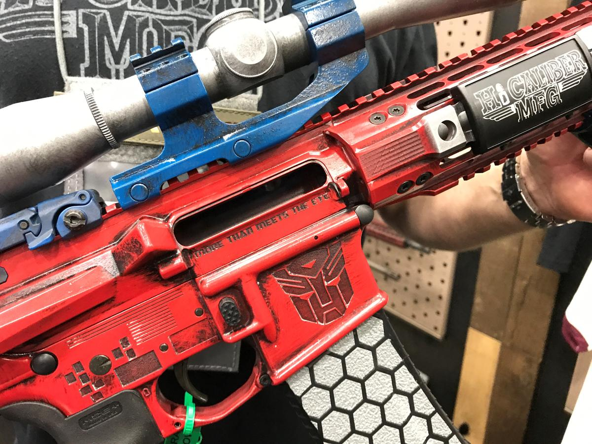 Casey Lewis shows off the rifle his Virginia-based company, HiCaliber Manufacturing, customized to look like the Transformer Optimus Prime.