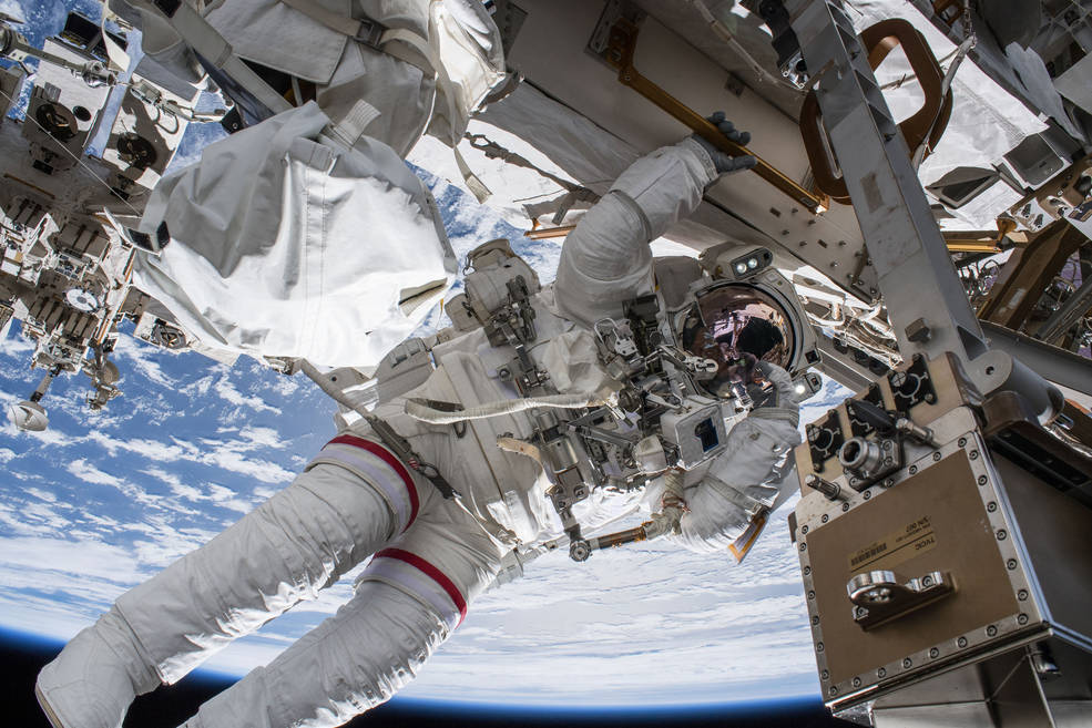 NASA astronaut Drew Feustel seemingly hangs off the International Space Station while conducting a spacewalk with fellow NASA astronaut Ricky Arnold (out of frame) on March 29, 2018. Feustel, as are all spacewalkers, was safely tethered at all times to the space station during the six-hour, ten-minute spacewalk.