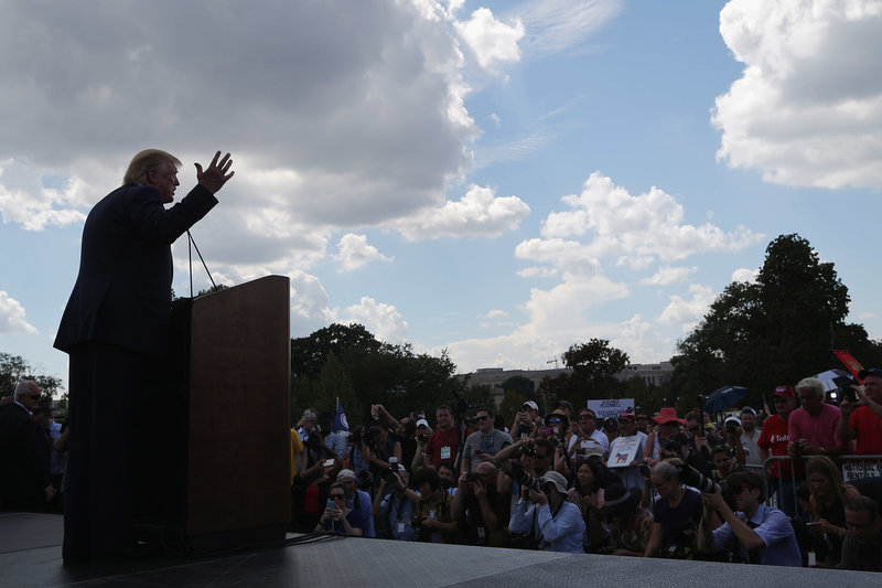 Then-presidential candidate Donald Trump addresses a rally against the Iran nuclear deal on the West Lawn of the U.S. Capitol on September 9, 2015, in Washington, D.C.