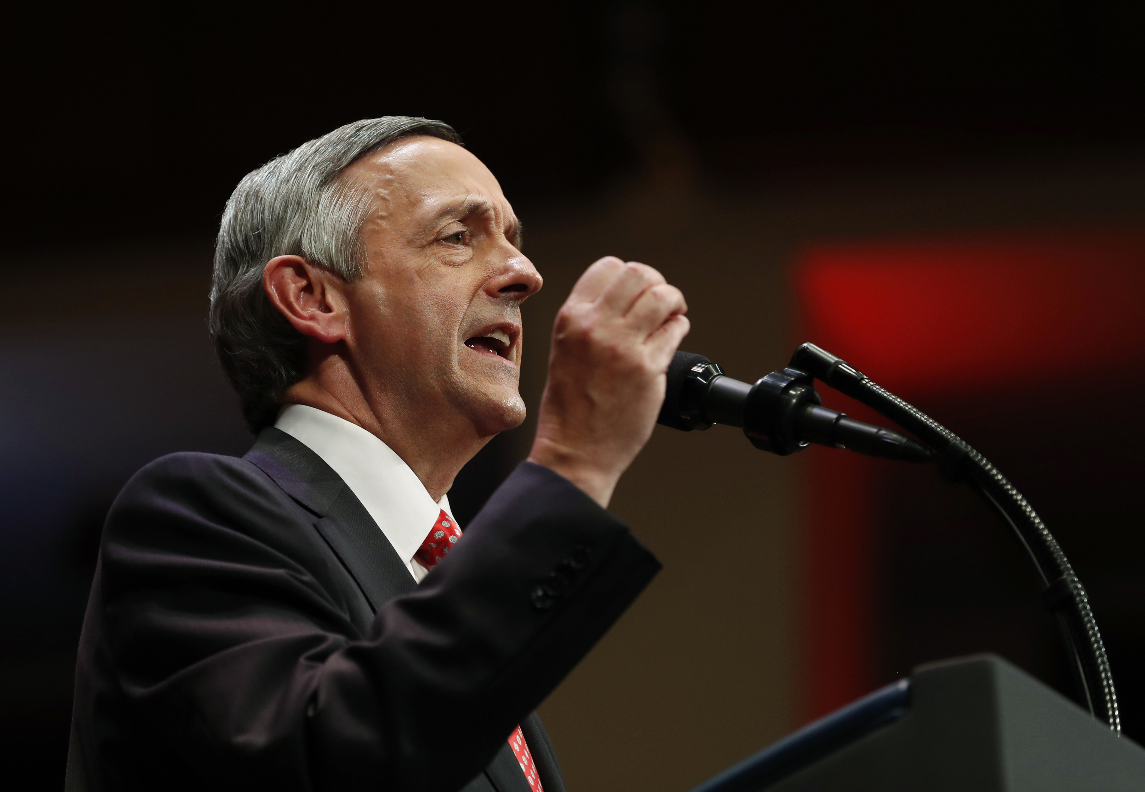 FILE - In this July 1, 2017, file photo, pastor Robert Jeffress, of the First Baptist Church in Dallas, speaks as he introduces President Donald Trump during the Celebrate Freedom event at the Kennedy Center for the Performing Arts in Washington. In a tweet Sunday, May 13, 2018, Senate candidate Mitt Romney of Utah says the prominent Baptist minister, Jeffress, shouldn't be giving the prayer that opens the U.S. Embassy in Jerusalem because he's a