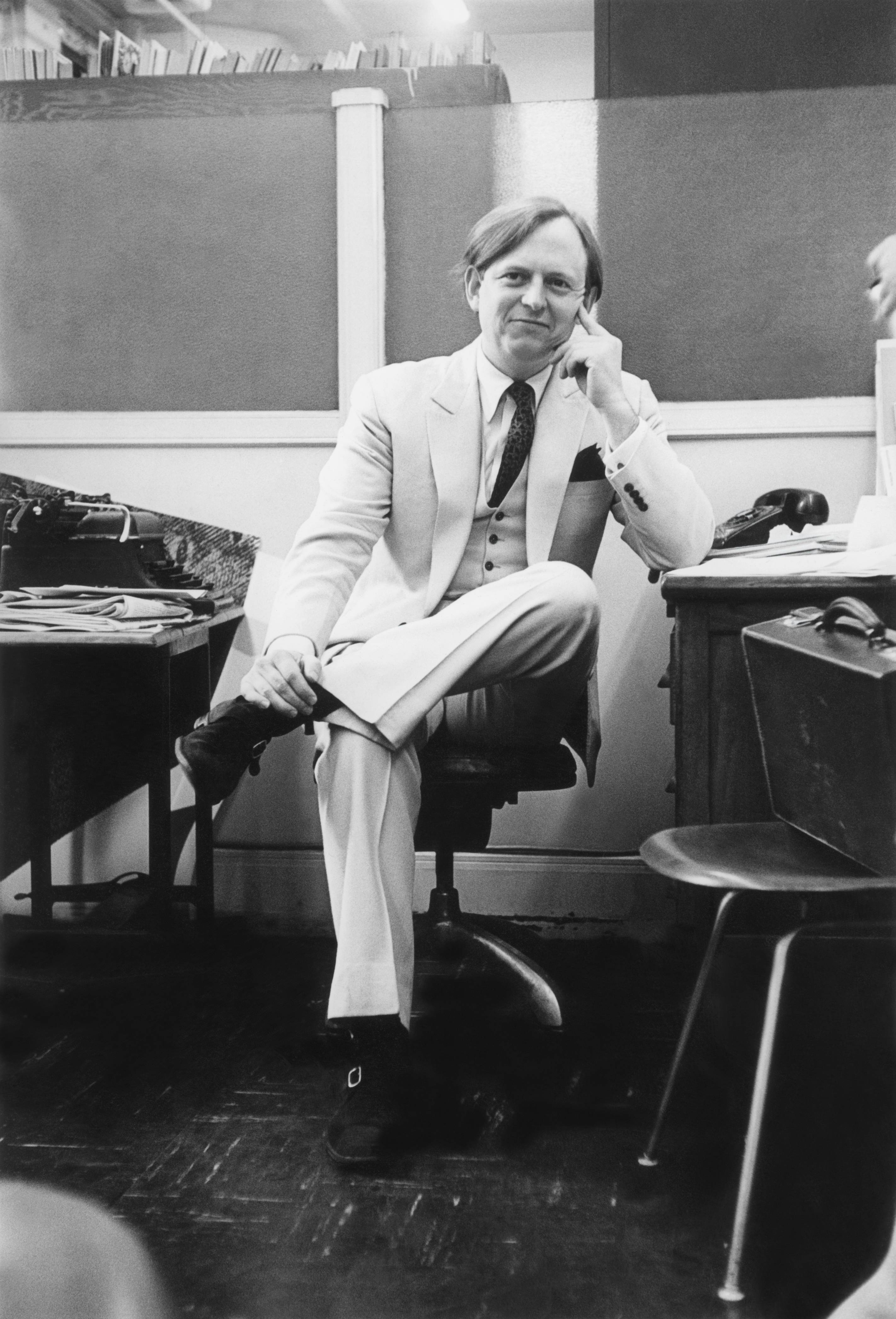 Wolfe — in his signature white suit in 1966 — coined or popularized phrases that became part of the American lexicon, such as