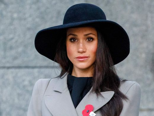 Meghan Markle attends an Anzac Day dawn service with Britain's Prince Harry, at Hyde Park Corner in London, Wednesday, April 25, 2018.