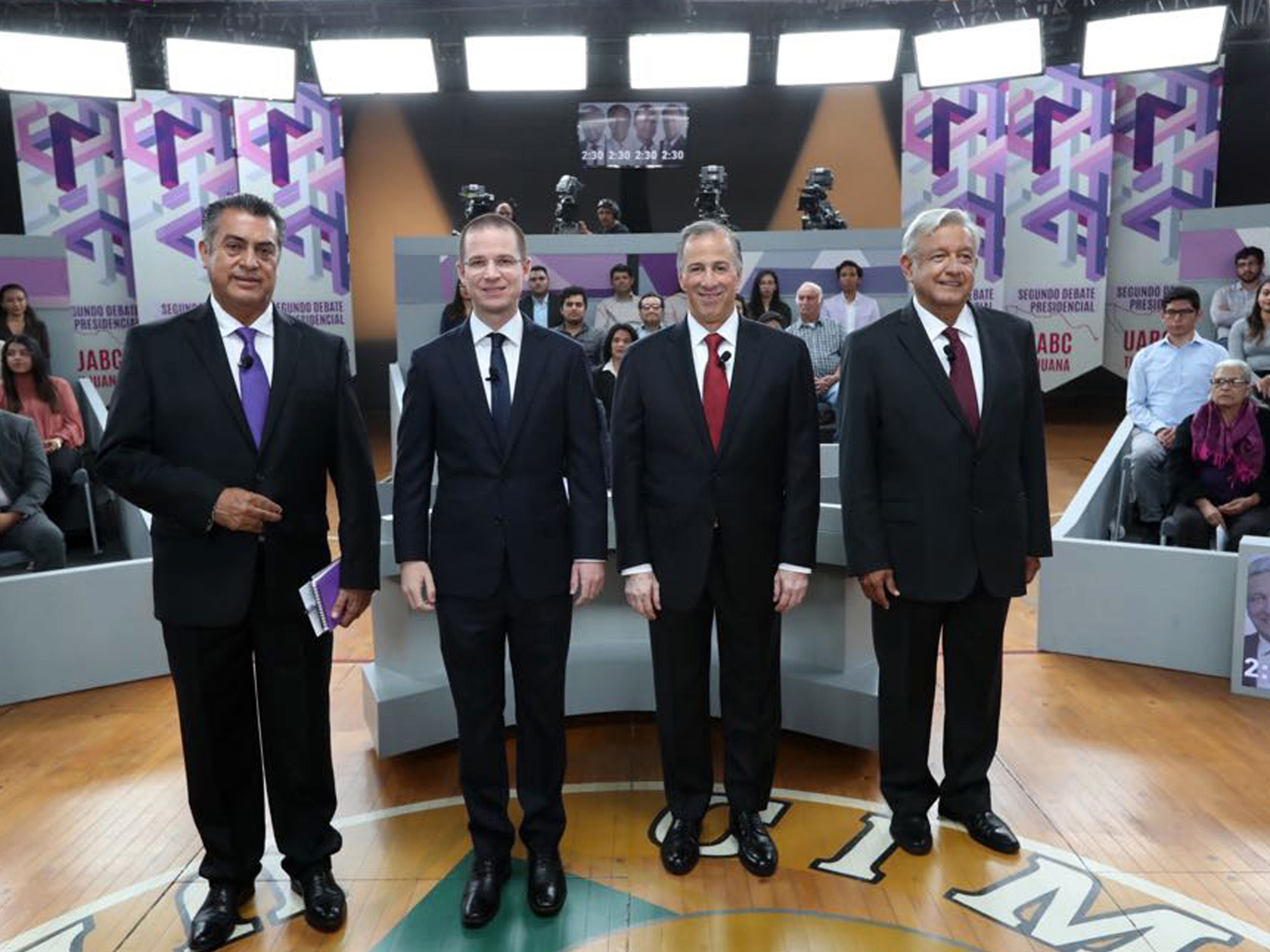 In this photo released by the National Electoral Institute (INE), presidential candidates ( from left) independent Jaime Rodriguez, known as