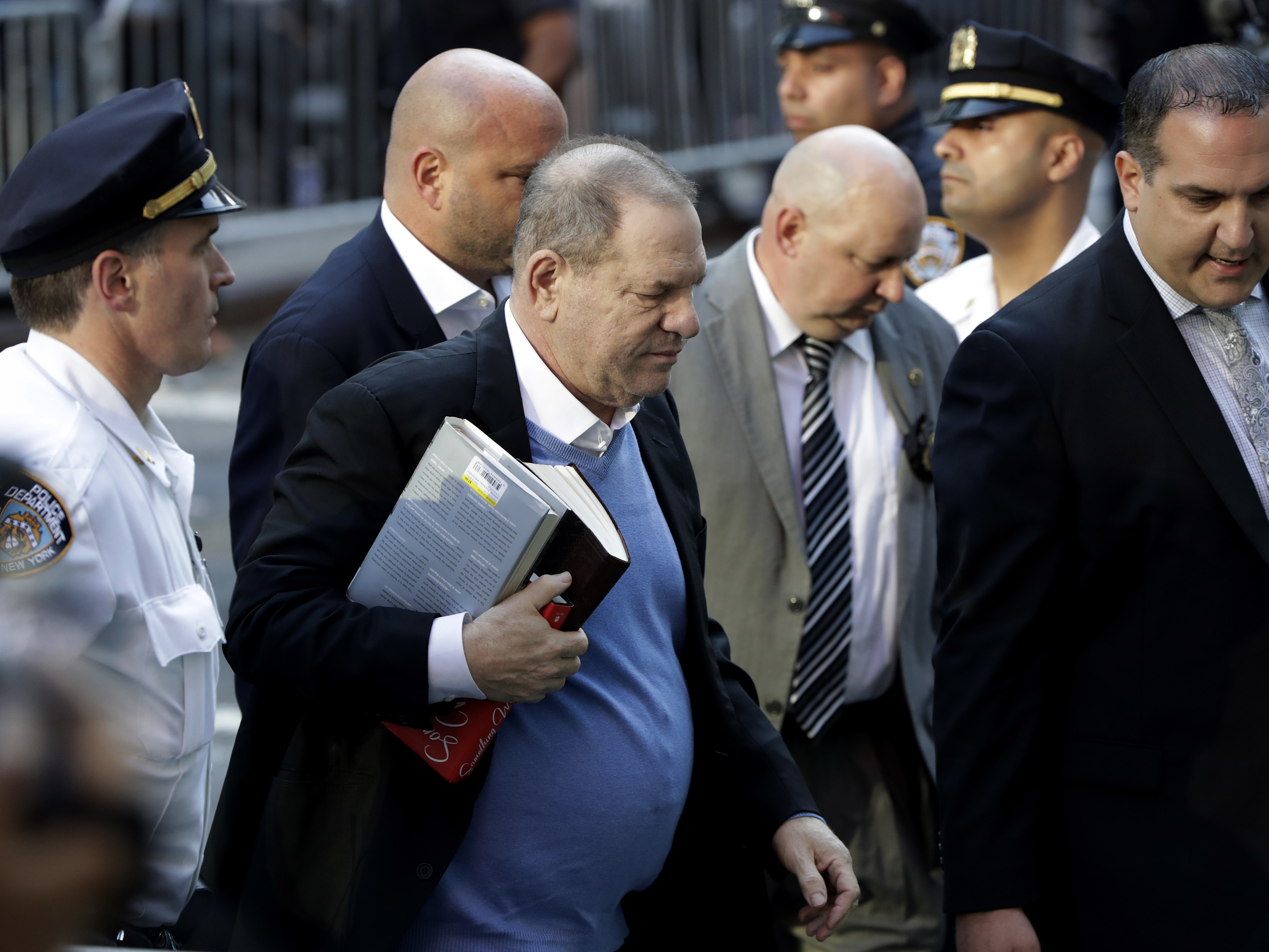 Harvey Weinstein turns himself in to police at a station in Manhattan on Friday morning.