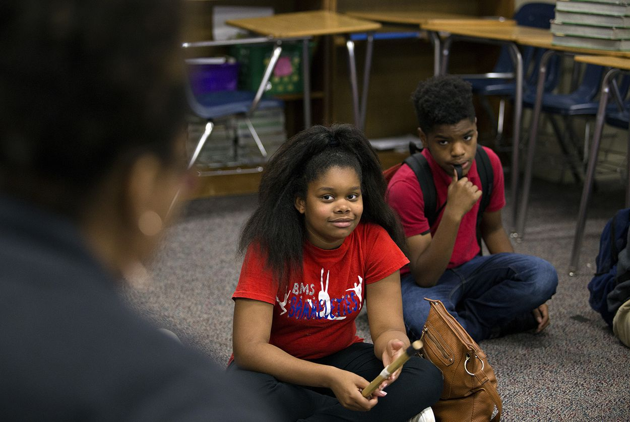 Yasmin Riculfy, a student at Bammel Middle School, listens to her teacher on April 20, 2018.