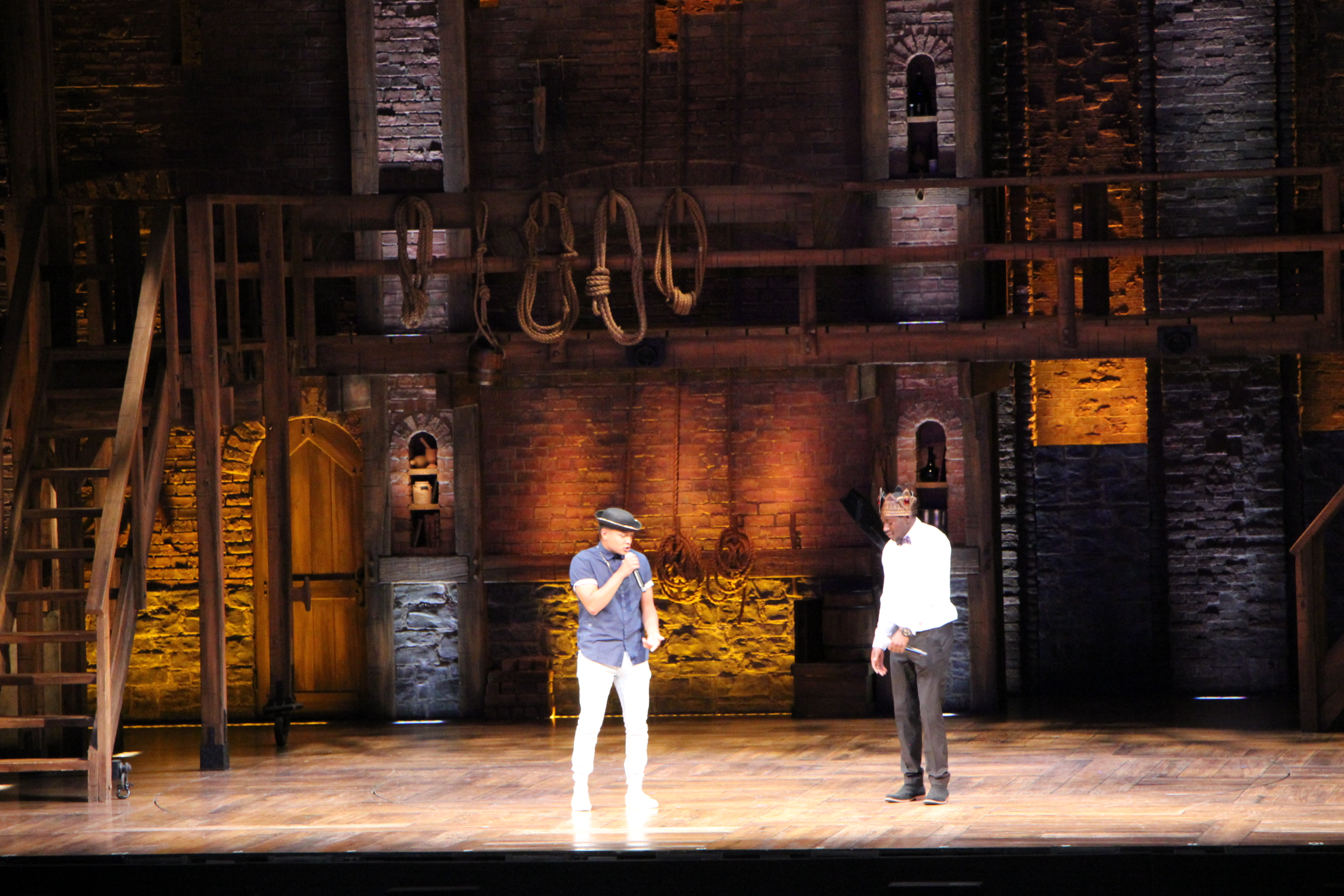 Matthew Luna (left) and Alphonzo Ward (right) perform King George v 13 Colonies Rap at the Hobby Center