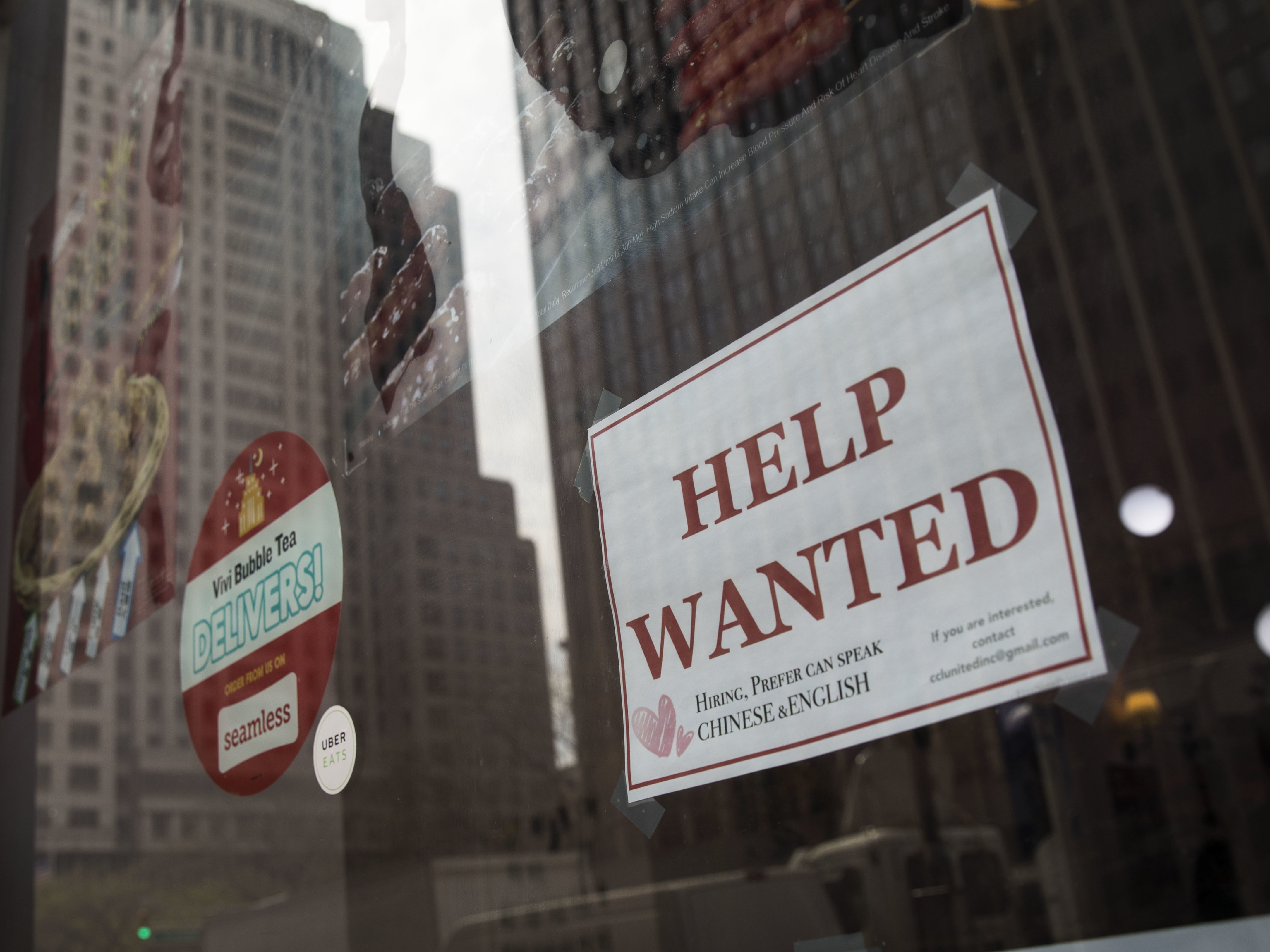 "A ""help wanted"" sign hangs on a window of a restaurant in New York City. The U.S. economy gained a stronger-than-expected 223,000 jobs last month and the unemployment rate edged down to an 18-year low"