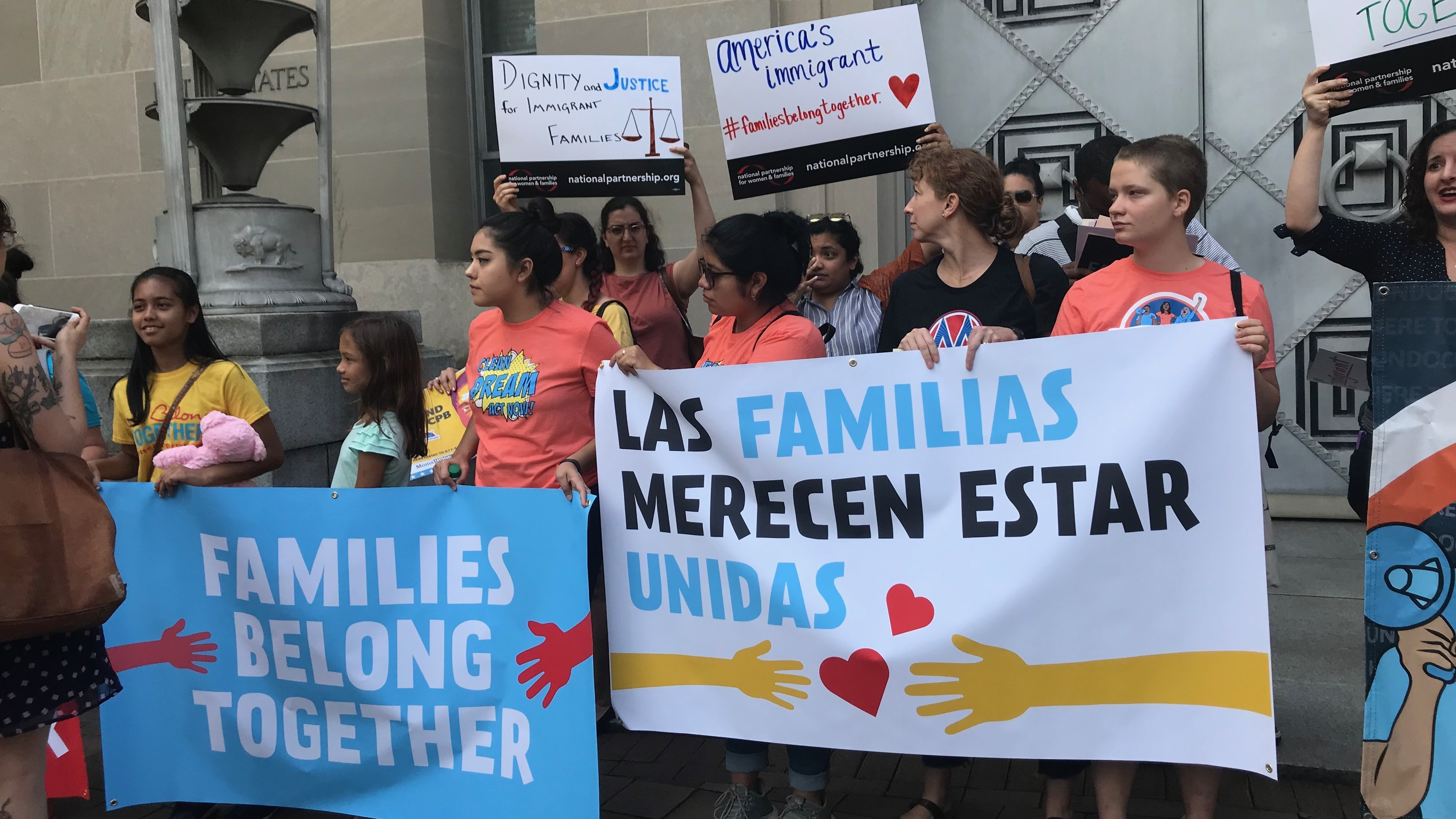 More than 100 people chanted and sang outside a Justice Department building in Washington, D.C., on Friday. The protesters gathered to condemn the Trump administration's practice of separating immigrant parents and children at the southern border.