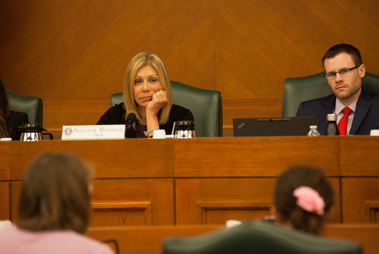 State Sen. Joan Huffman, R-Houston, listens to the Gonzales family speak against SB 3 and SB 91, the