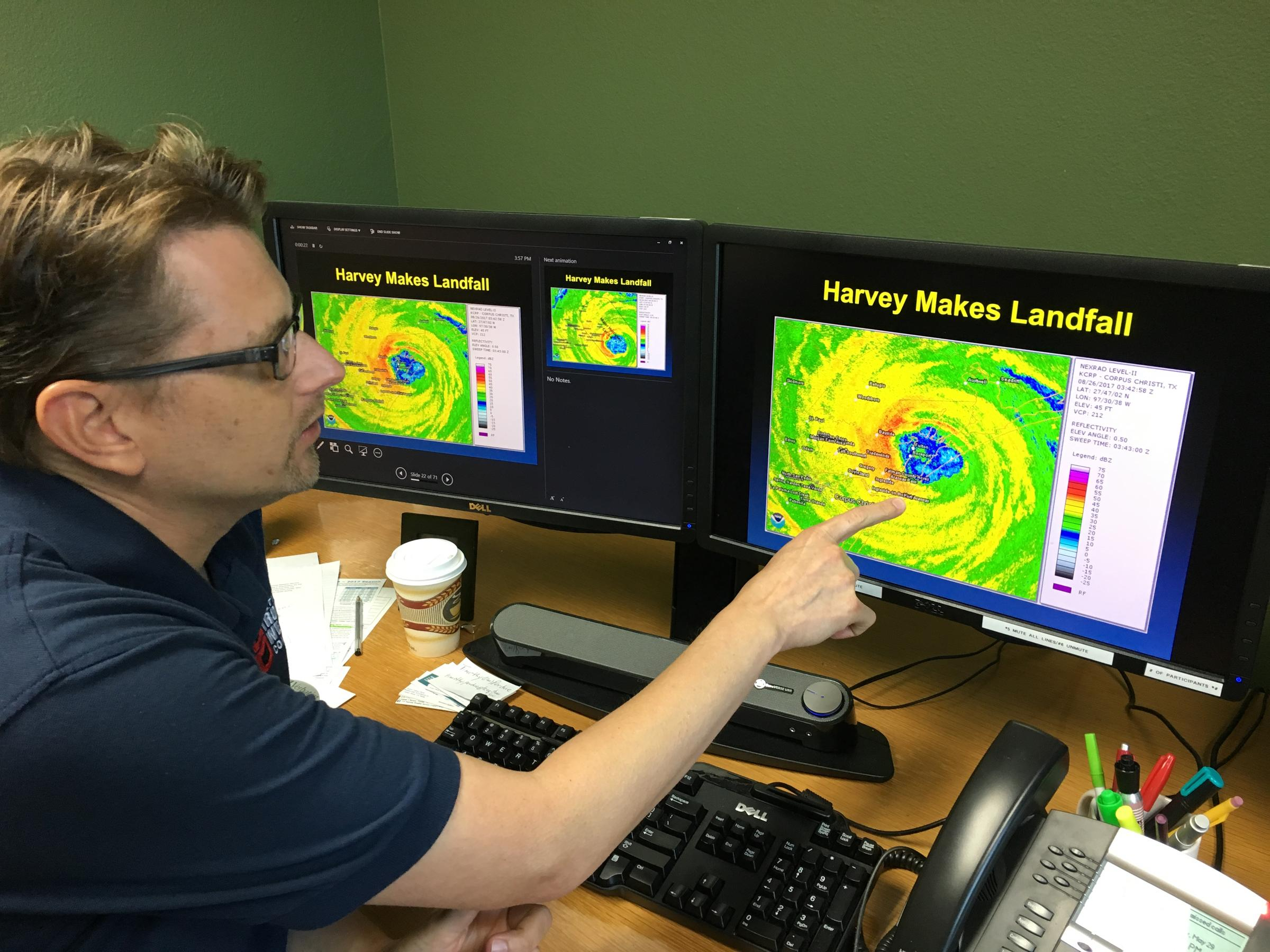 National Weather Service Meteorologist John Metz points at the eye wall of Harvey as the came ashore.