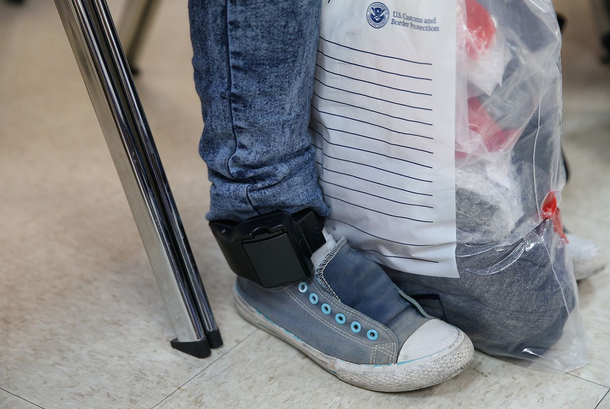 After being detained and released by law enforcement, an undocumented immigrant wears an ankle monitor at the Catholic Charities relief center in McAllen on April 6, 2018.
