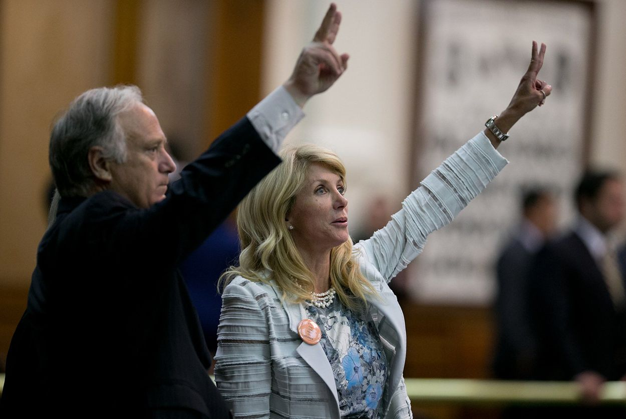 State Sens. Kirk Watson and Wendy Davis, late in the evening of Davis' filibuster five years ago, on June 25, 2013. Davis temporarily blocked a bill imposing restrictions on abortion clinics in Texas.