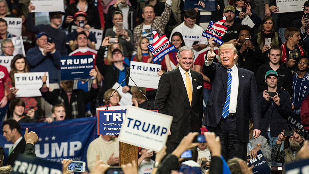 Then-candidate Donald Trump is introduced by then-South Carolina Lt. Gov. Henry McMaster at a campaign rally in Florence, S.C., in 2016. Now Trump is president and McMaster is governor and campaigning for a full term.