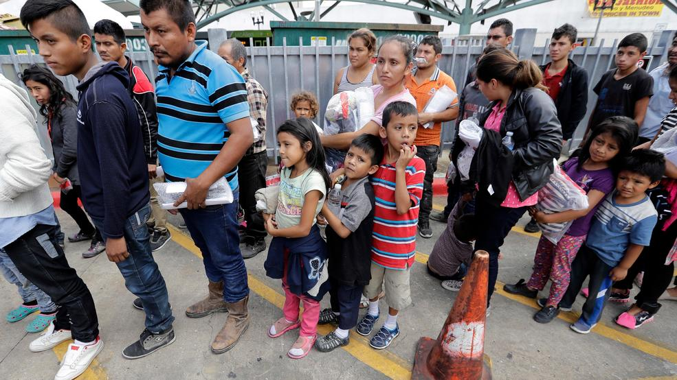 Immigrant families line up to enter the central bus station after they were processed and released by U.S. Customs and Border Protection, Sunday, June 24, 2018, in McAllen, Texas.