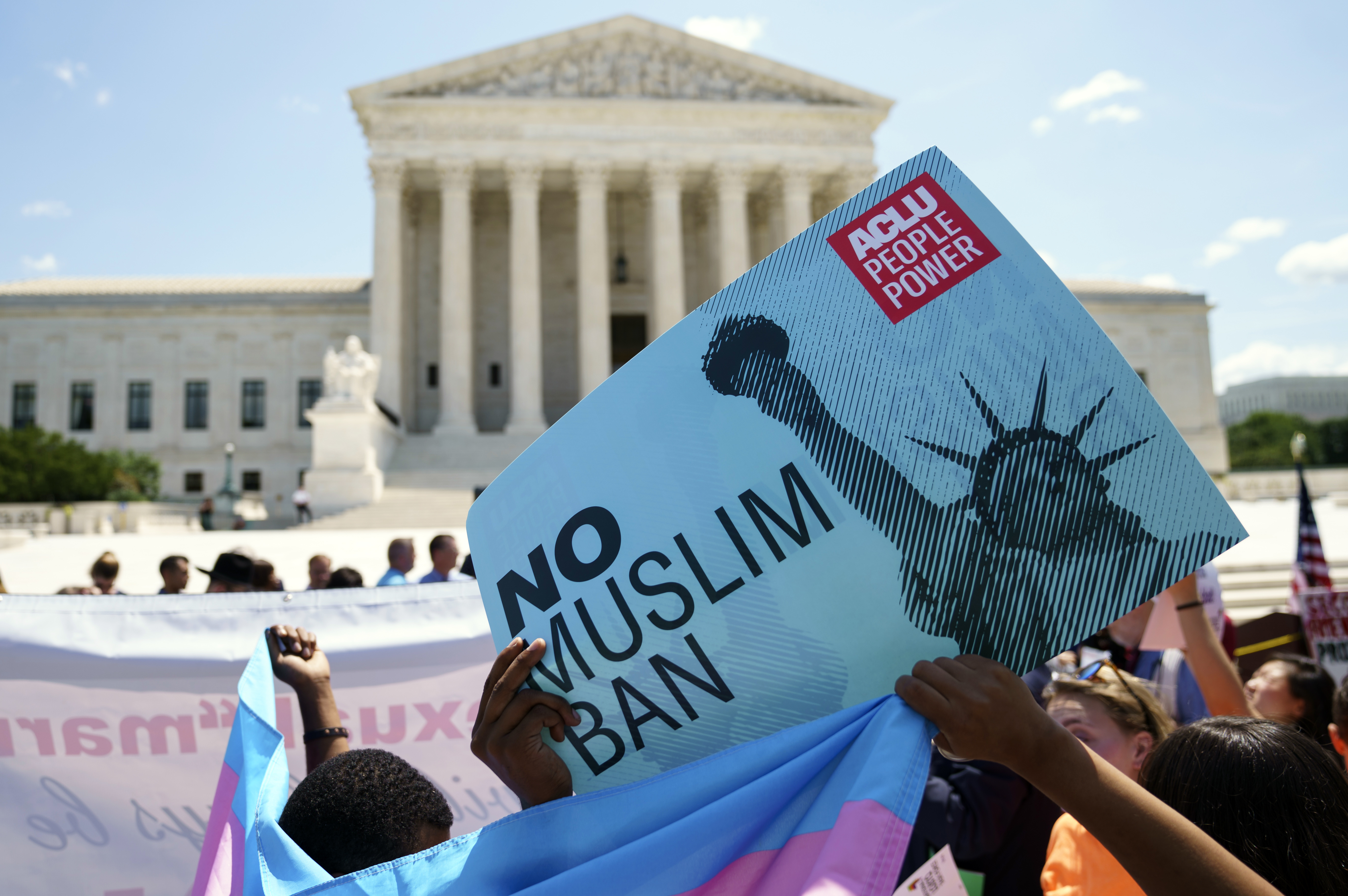 Protester call out against the Supreme Court ruling upholding President Donald Trump's travel ban outside the the Supreme Court in Washington, Tuesday, June 26, 2018. (AP Photo/Carolyn Kaster)
