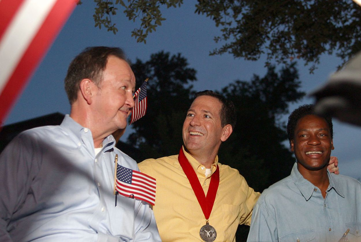 Left to right: John Lawrence, Attorney Mitchell Katine and Tyron Garner celebrate the recent landmark Supreme Court ruling on a Texas sodomy law, during a gay pride parade in Houston on June 28, 2003.